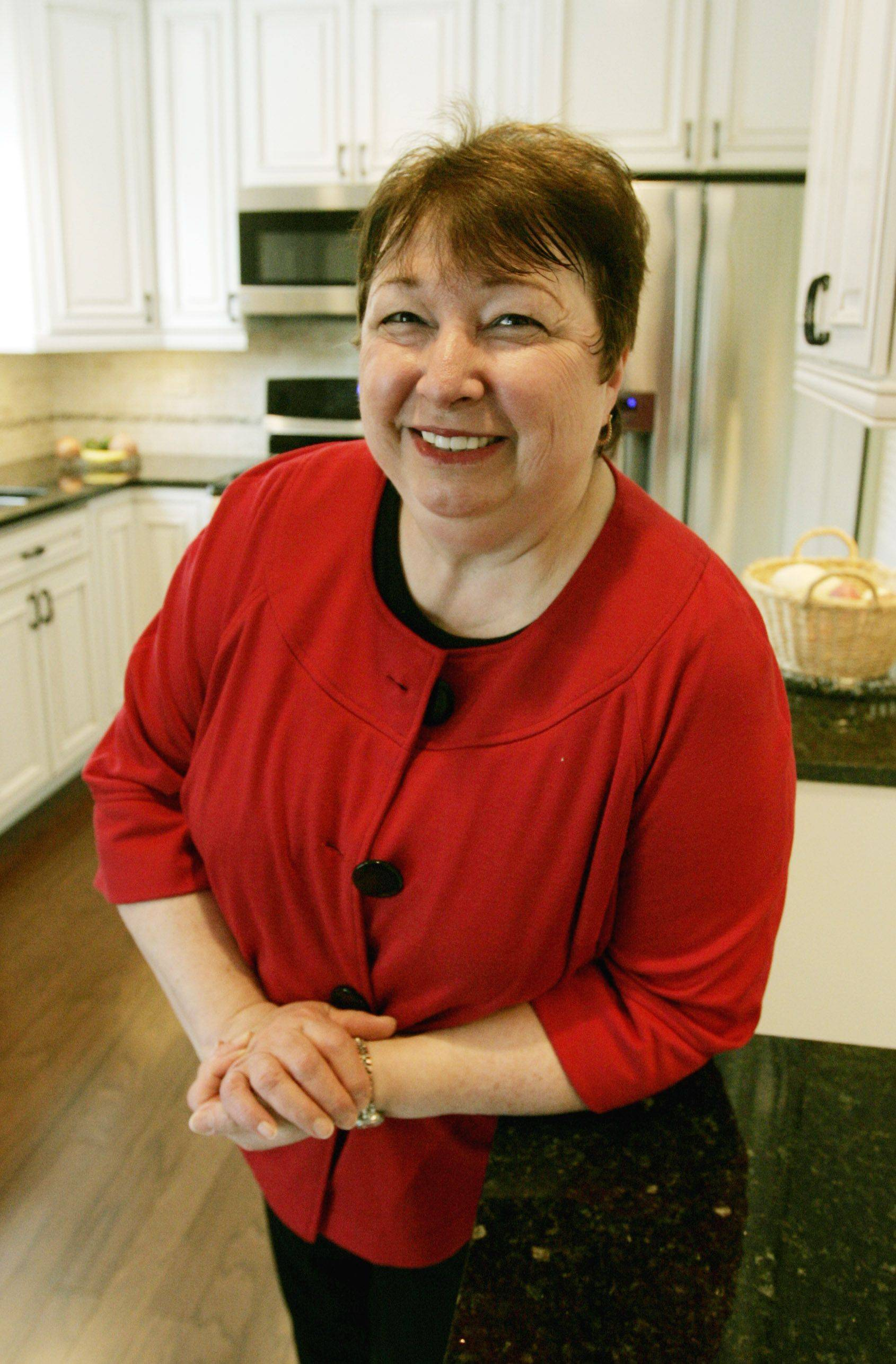 Tanit jarusan/tjarusan@dailyherald.comPat Hoffman and her remodeled kitchen that opens to the family room and opened the floor plan in Woodridge.