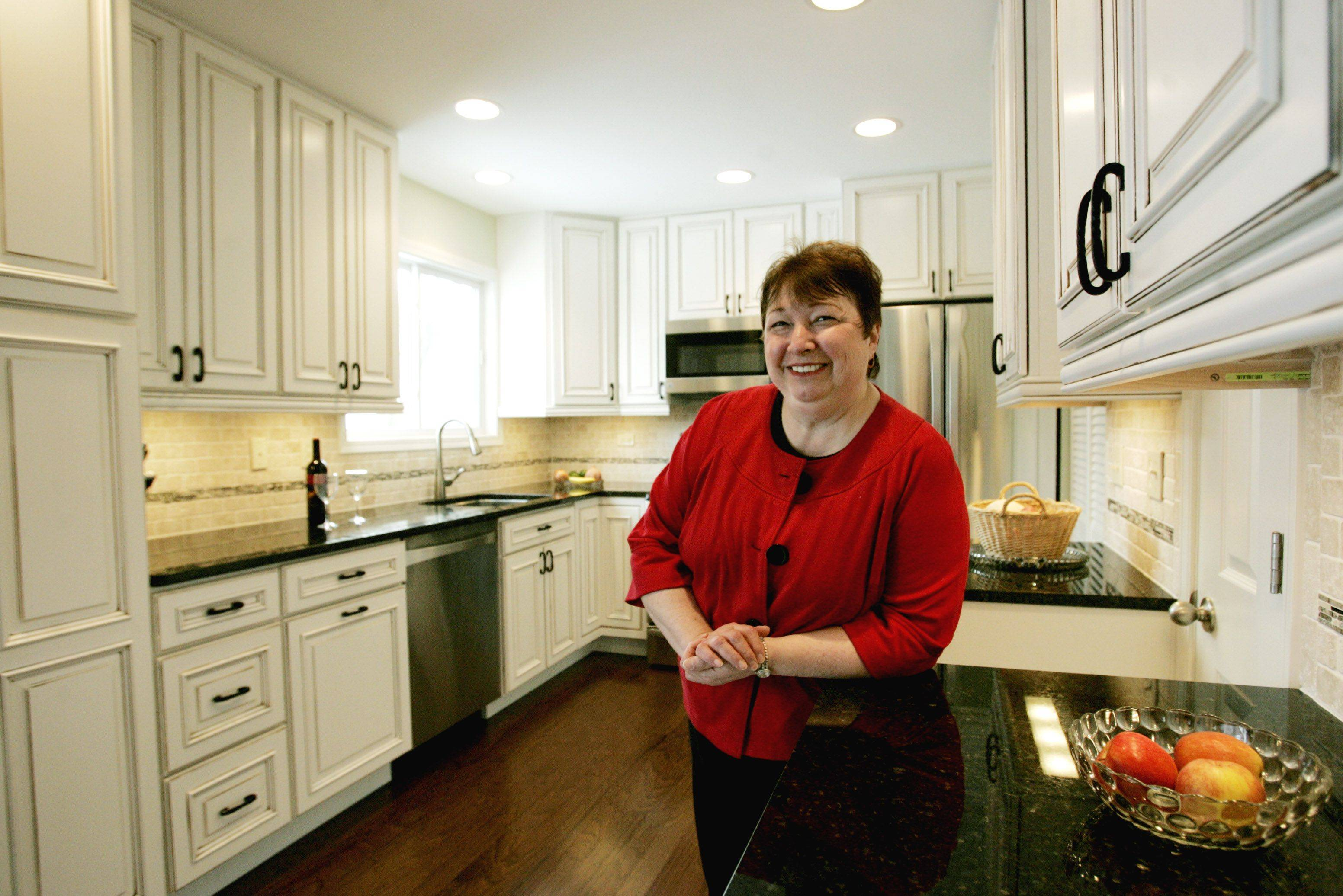 Tanit jarusan/tjarusan@dailyherald.comPat Hoffman in her remodeled kitchen that opens to the family room and opened the floor plan in Woodridge.