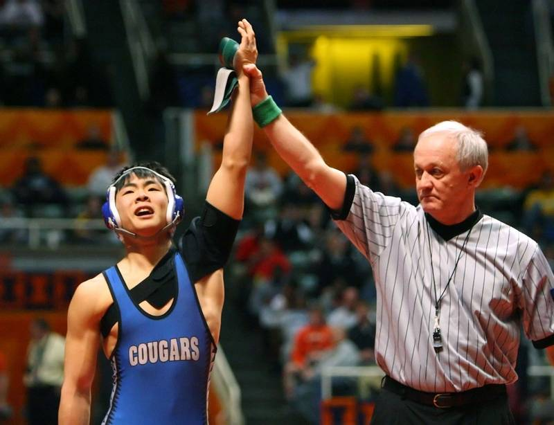 Vernon Hills' Gideon Yim rejoices after a pin during his match at 125  pounds during