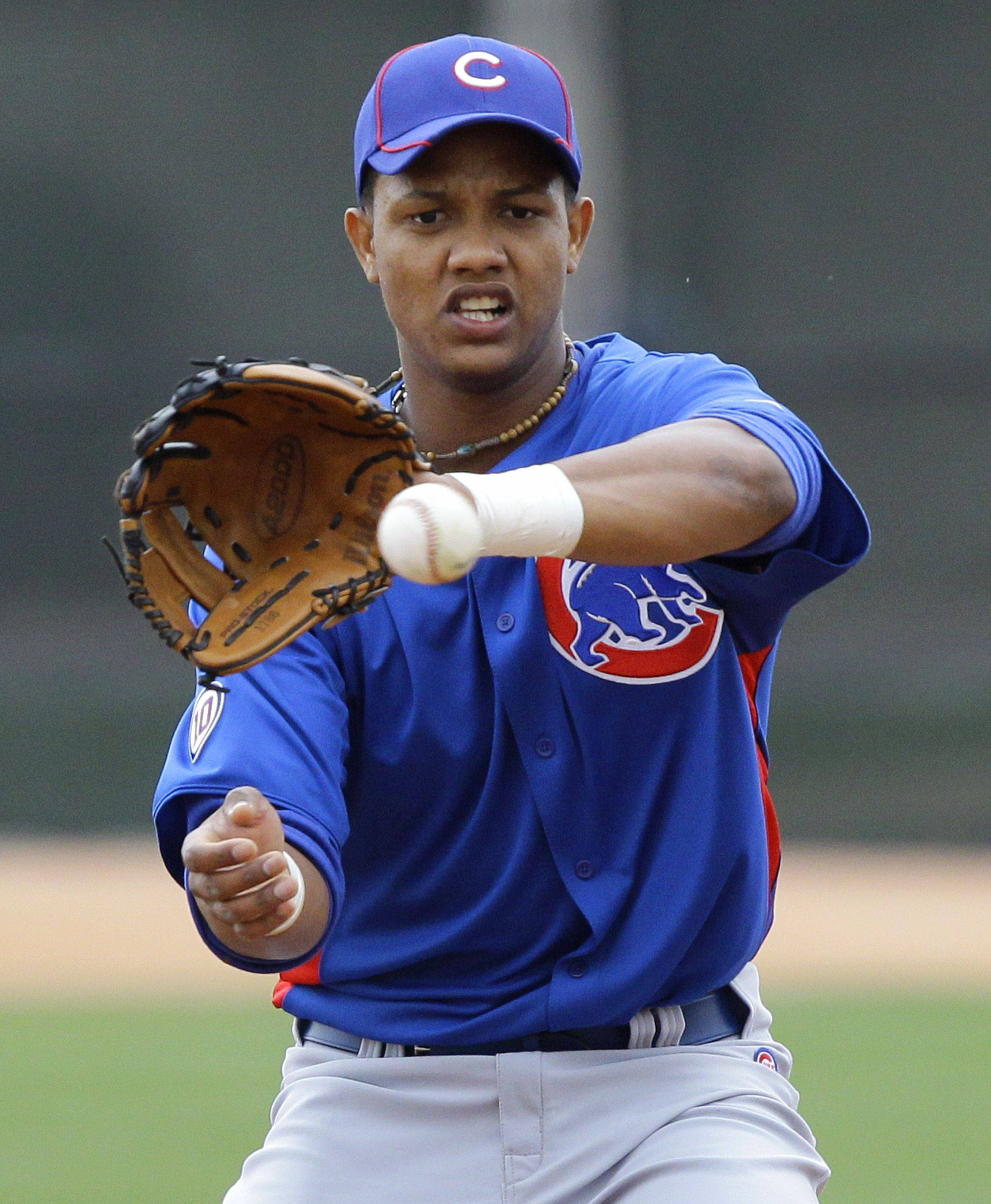 Chicago Cubs infielder Starlin Castro takes fielding practice, Saturday, Feb. 19, 2011, at the Cubs' baseball spring training facility in Mesa, Ariz.