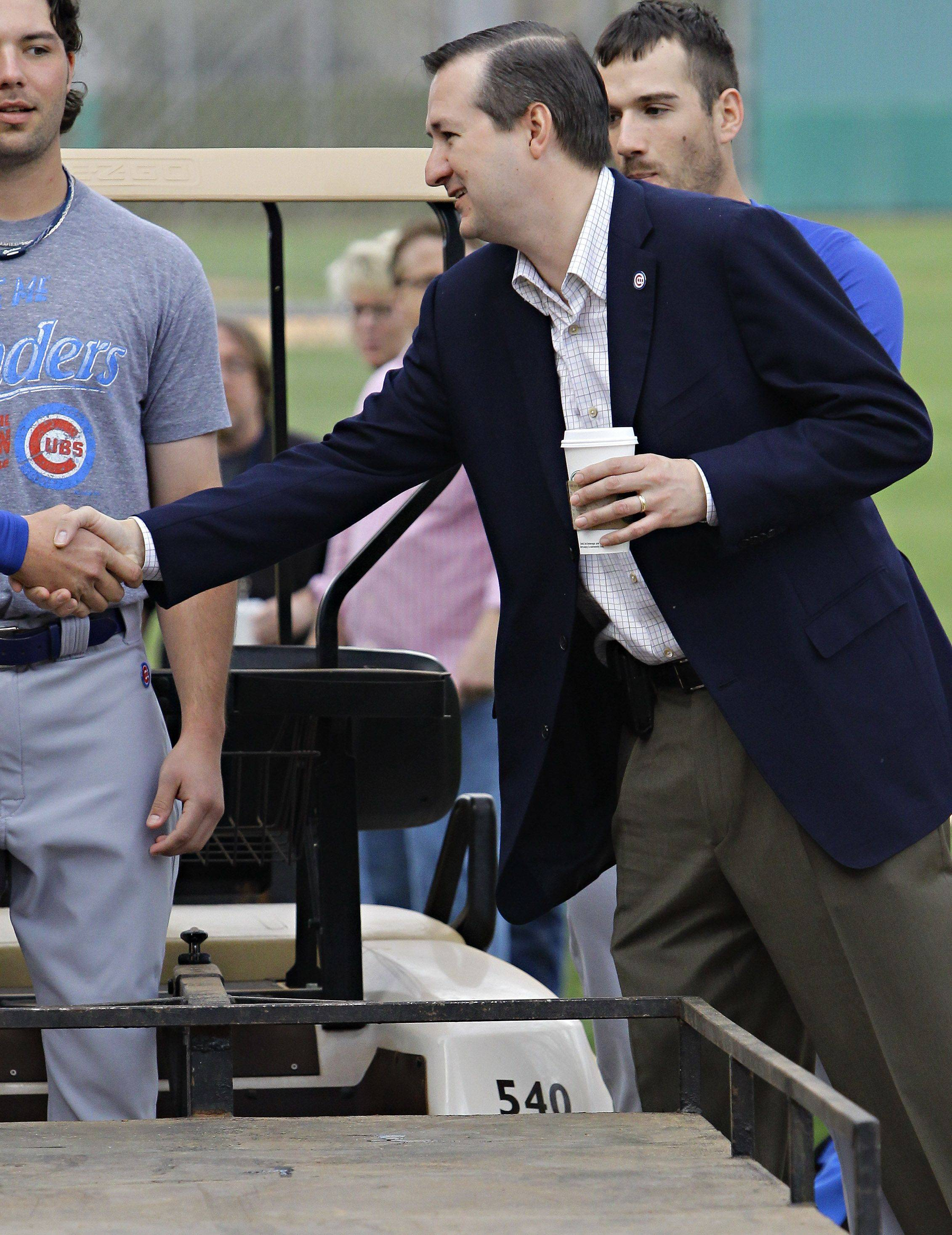 Chicago Cubs owner Tom Ricketts greets his players Saturday, Feb. 19, 2011 at the Cubs' baseball spring training facility in Mesa, Ariz.