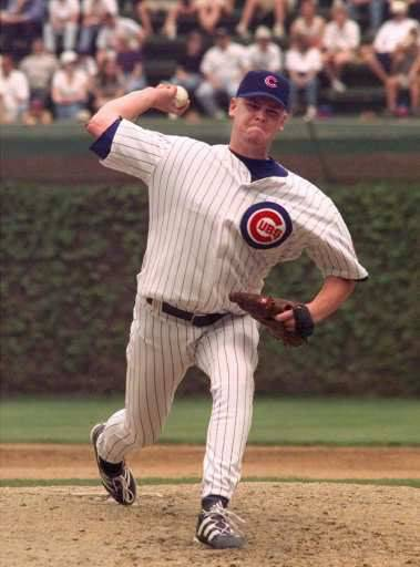 Chicago Cubs rookie Kerry Wood delivers a pitch to a Houston Astros batter during the fifth inning Wednesday, May 6, 1998, in Chicago. Wood tied the major league record with 20 strikeouts in a nine-inning game, pitching a one-hitter to beat the Astros 2-0.