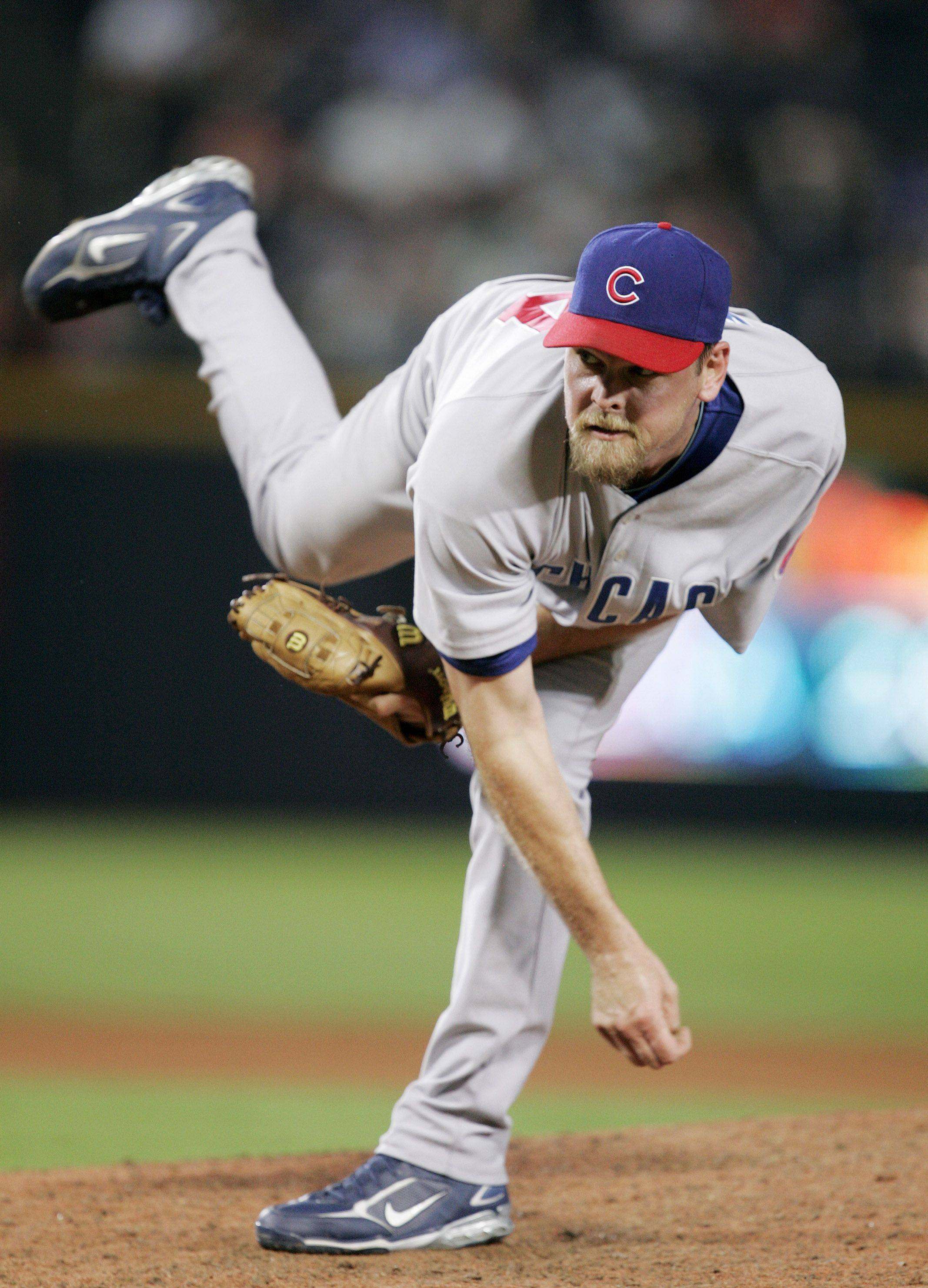 In this Aug. 13, 2008 file photo, Chicago Cubs pitcher Kerry Wood throws against the Atlanta Braves in the eighth inning of a baseball game in Atlanta.
