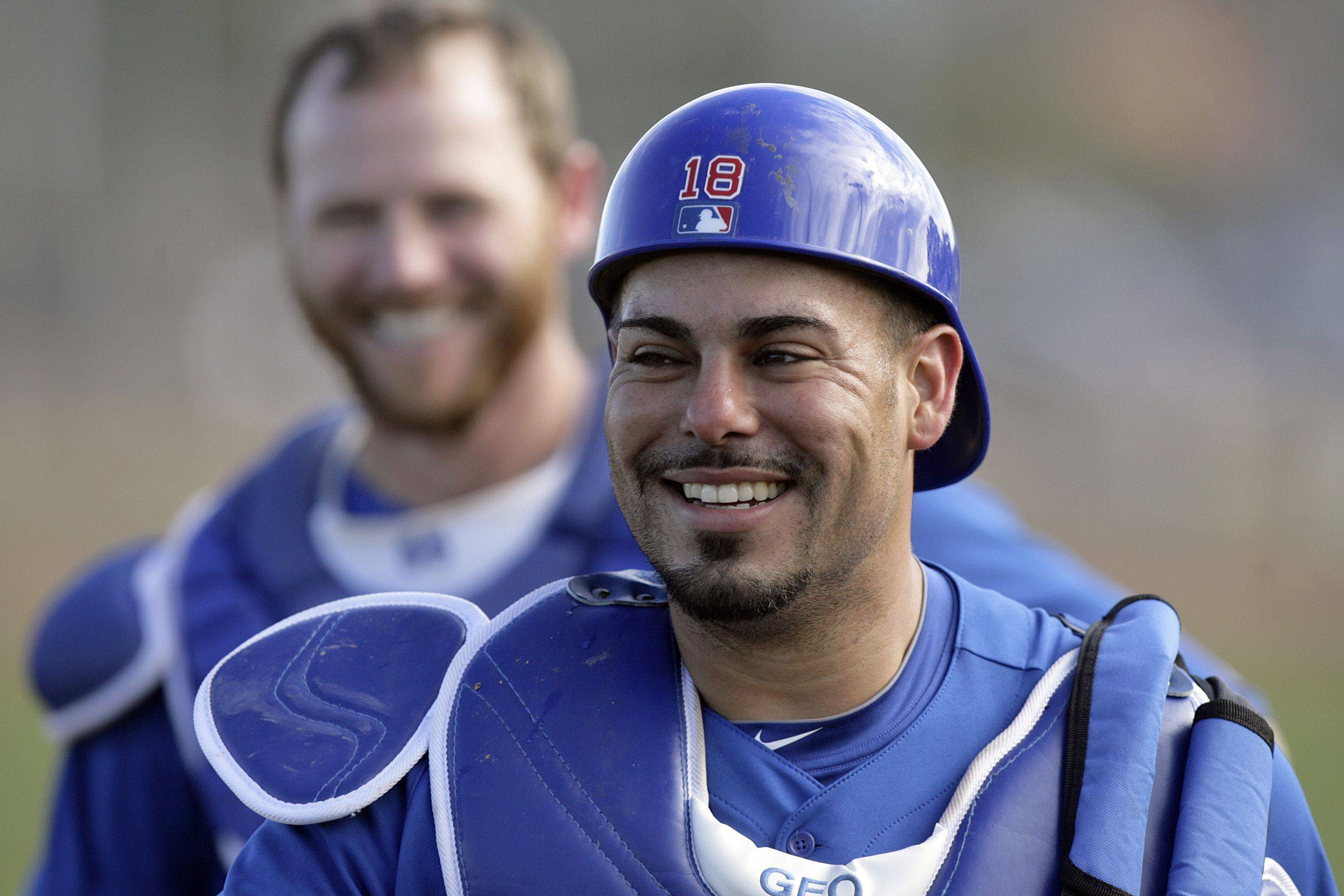 Chicago Cubs catchers Geovany Soto, right, and Koyie Hill make their way to a practice field to run drills during baseball spring training Monday, Feb. 21, 2011, in Mesa, Ariz.