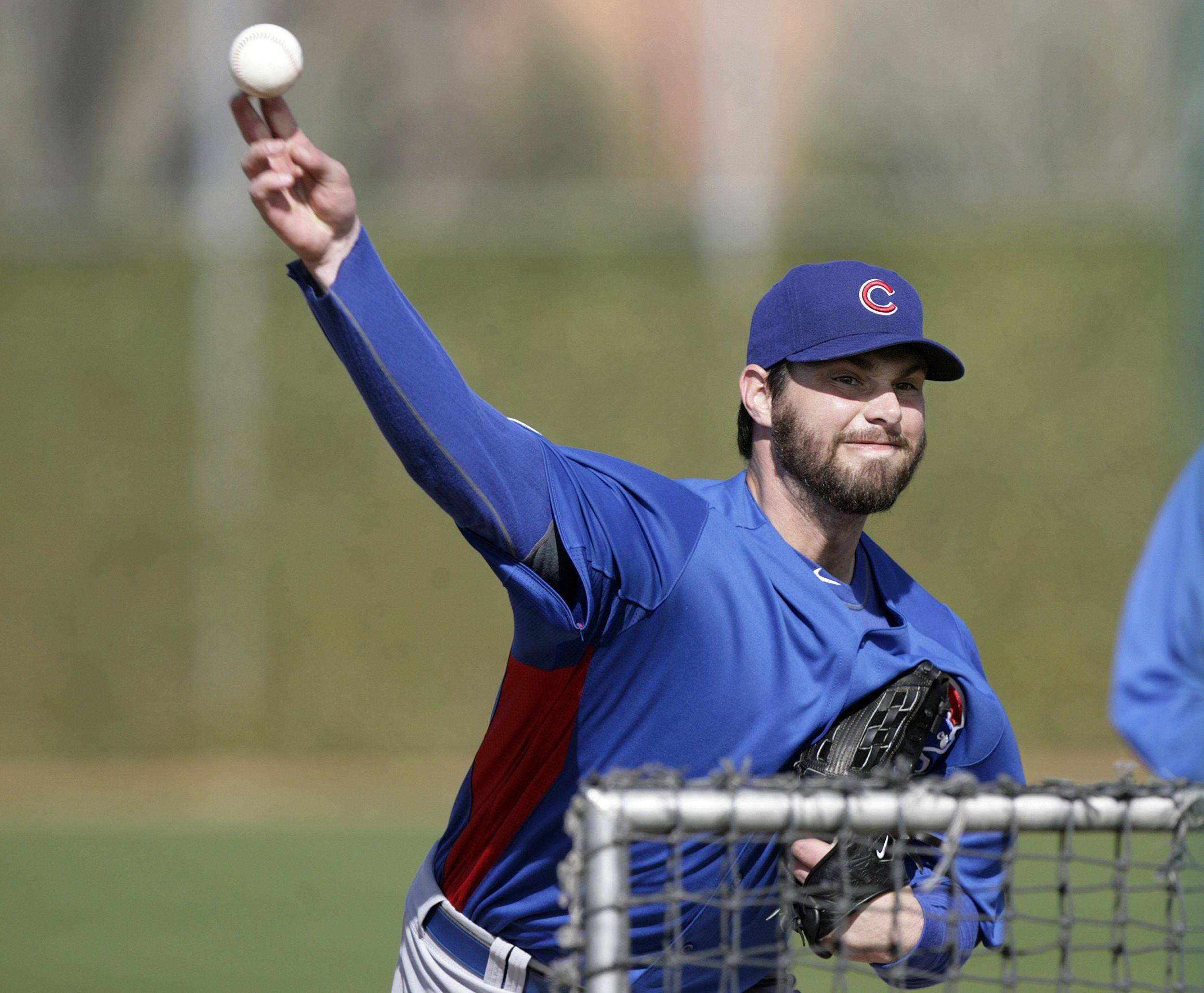 Chicago Cubs pitcher Randy Wells throws during batting practice at the team's spring training baseball facility Monday, Feb. 21, 2011, in Mesa, Ariz.