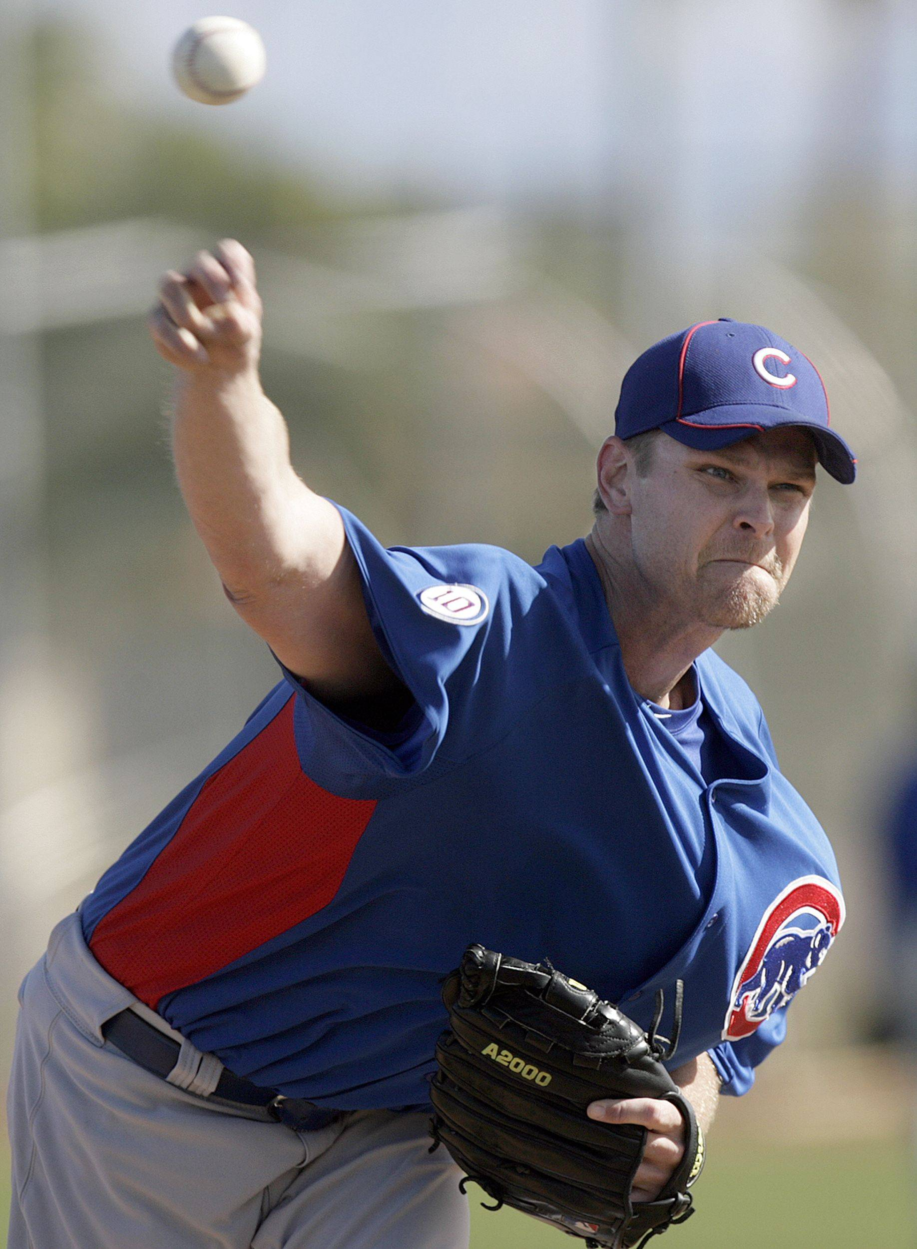 Chicago Cubs pitcher Kerry Wood throws during batting practice at the team's spring training baseball facility Monday, Feb. 21, 2011, in Mesa, Ariz.