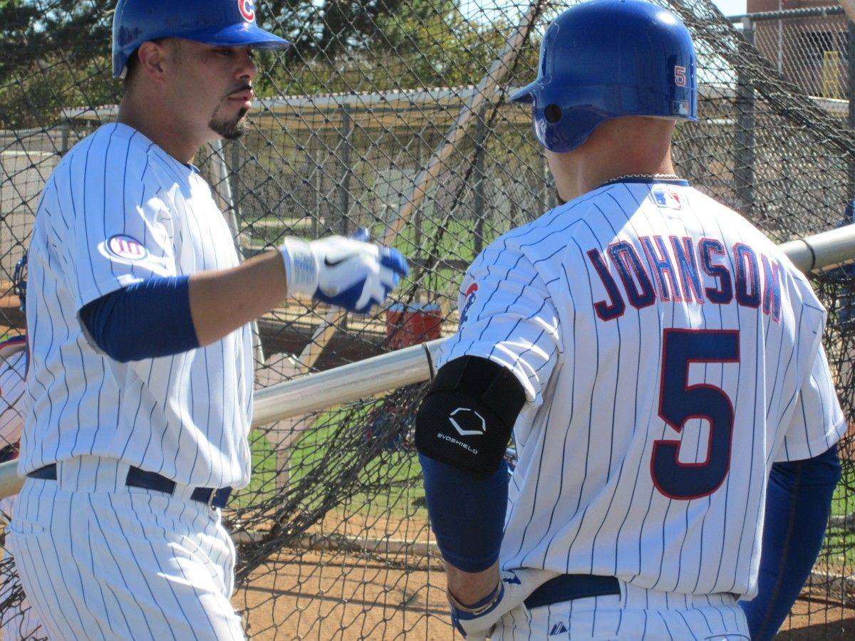 Reed Johnson talks with catcher Geovany Soto at Cubs camp Tuesday in Mesa, Ariz. Johnson is wearing an elbow guard after being hit by a pitch Sunday from Carlos Marmol. Johnson faced Marmol again Tuesday in batting practice without incident.