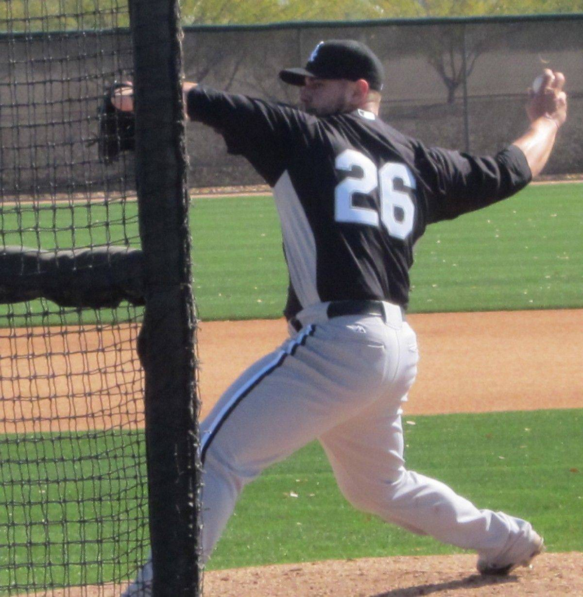 New White Sox relief pitcher Jesse Crain gets some work in Monday at Sox training facilities in Glendale, Ariz.