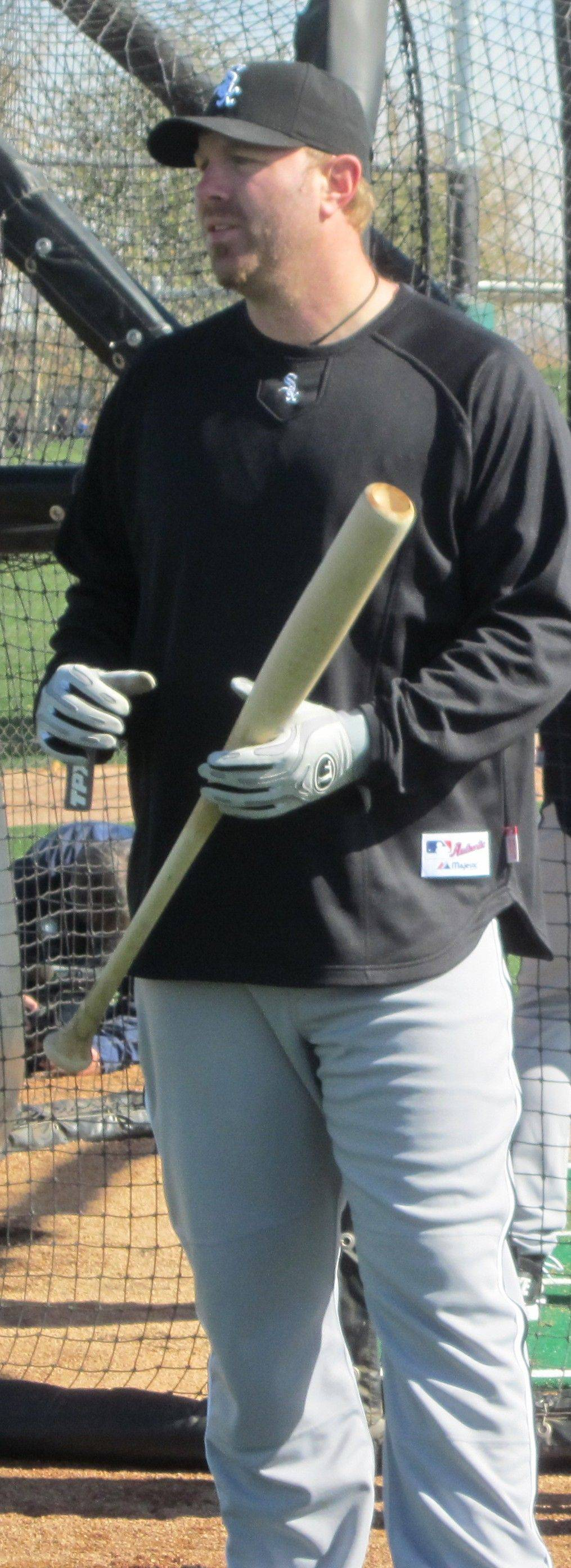 Adam Dunn gets ready for batting practice Monday at the White Sox training facilities in Glendale, Ariz.