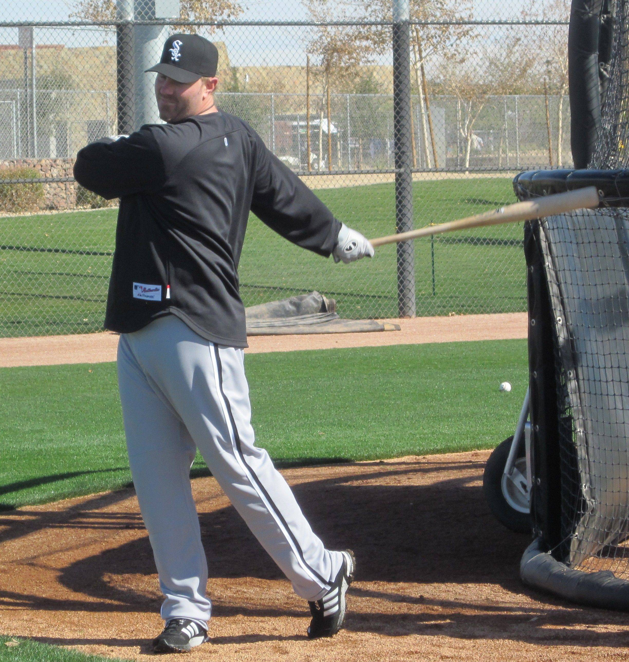 White Sox slugger Adam Dunn gets loose Monday at the White Sox training facilities in Glendale, Ariz.