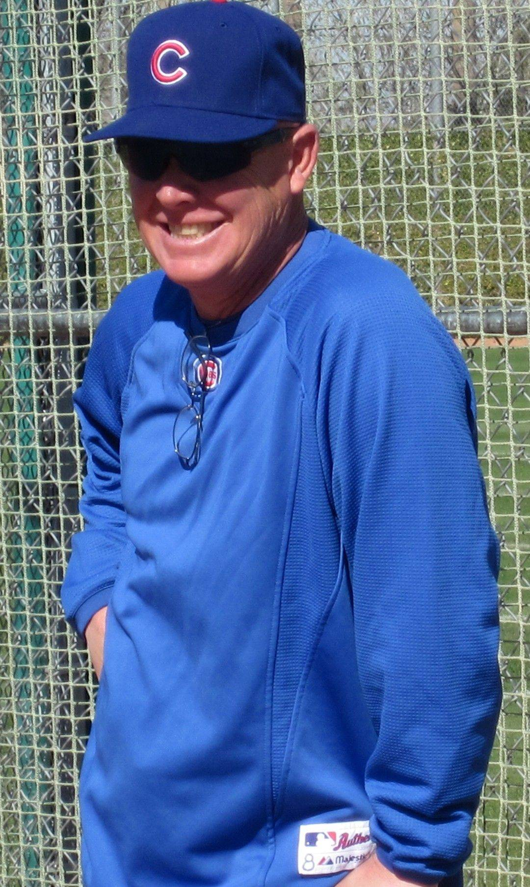 Cubs Manager Mike Quade addresses the media as the Cubs practice Tuesday in Mesa, Ariz.