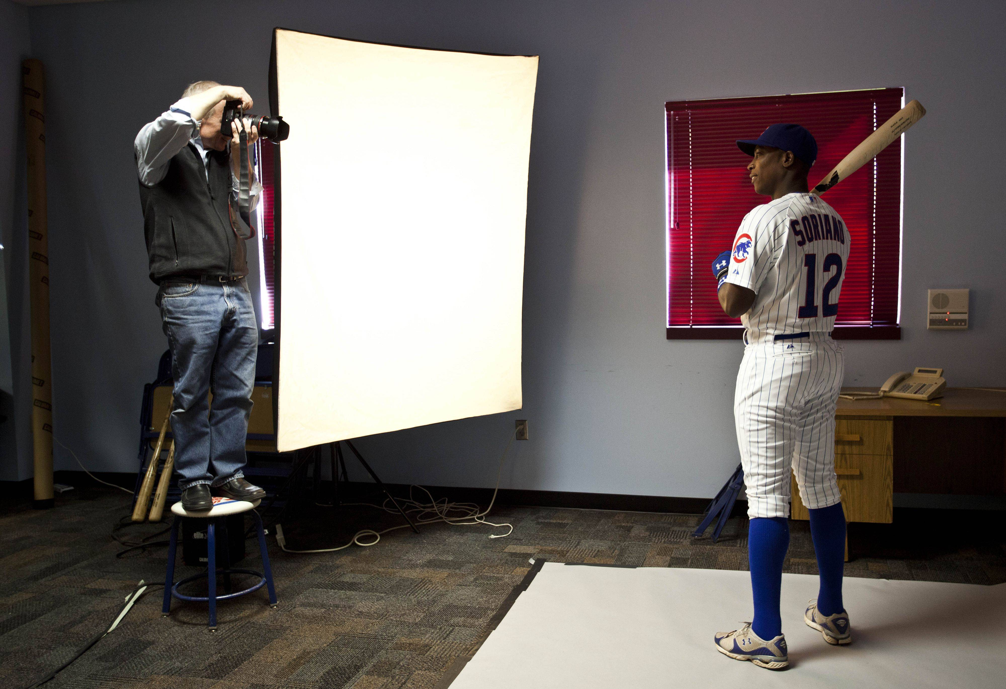 Chicago Cubs team photographer Stephen Green takes a picture of Alfonso Soriano during photo day at baseball spring training, Tuesday, Feb. 22, 2011, in Mesa, Ariz.
