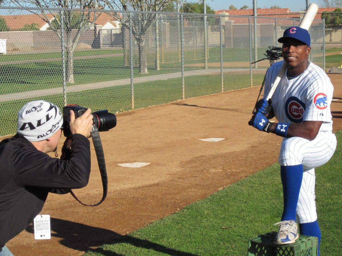 It was photo day Tuesday at Cubs training camp in Mesa, Ariz., and outfielder Alfonso Soriano provides a baseball-card type pose to get the day rolling.