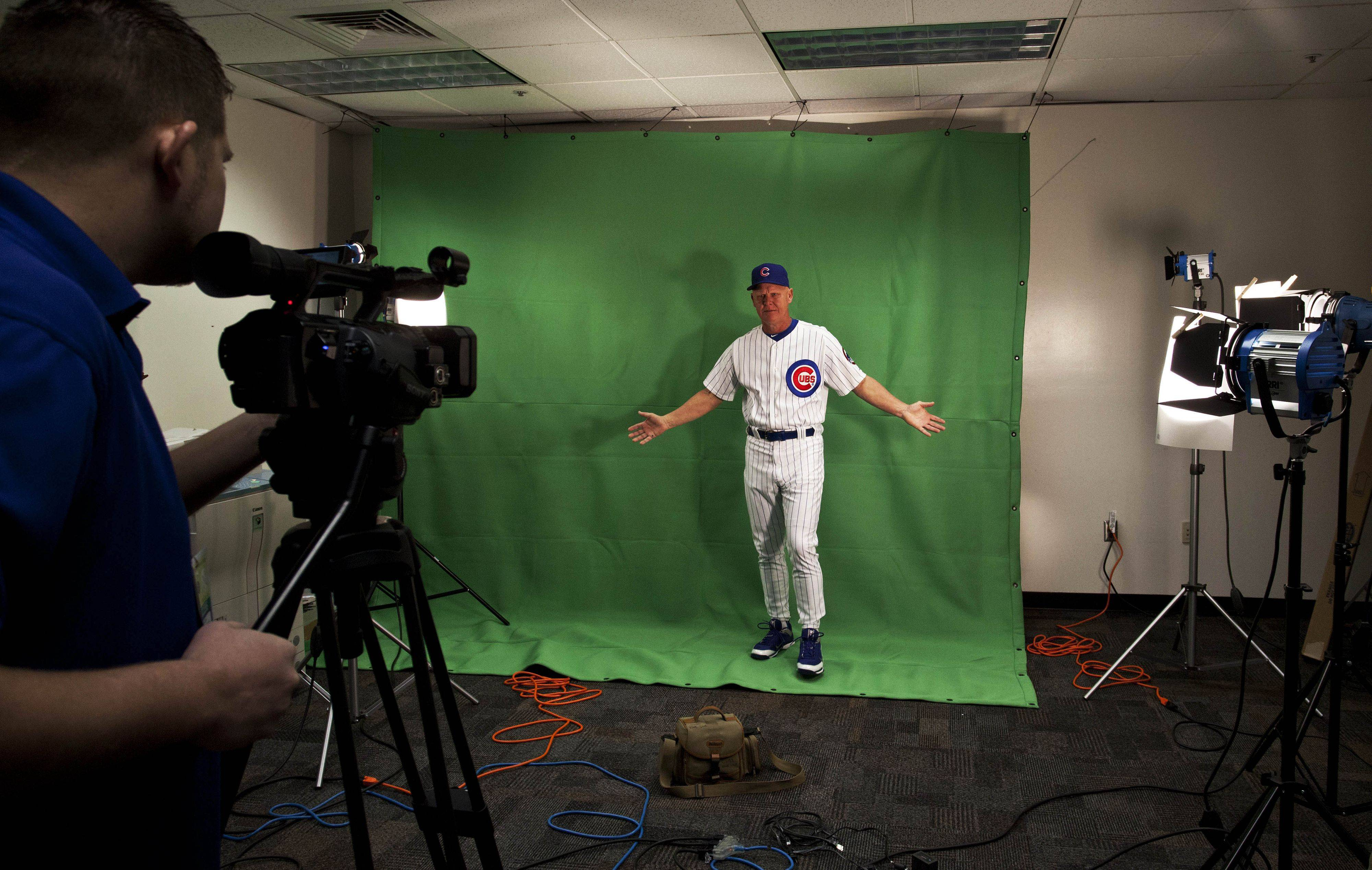 Chicago Cubs manager Mike Quade gestures during the baseball team's photo day at spring training, Tuesday, Feb. 22, 2011, in Mesa, Ariz.
