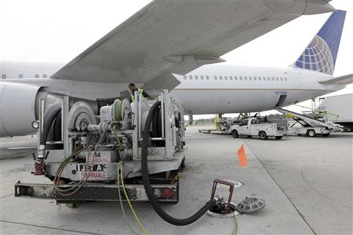 A Continental Airlines plane is fueled at George Bush Intercontinental Airport in Houston. For the first time since late 2008, airlines are adding fuel surcharges _ extra fees to cover the price of gas.