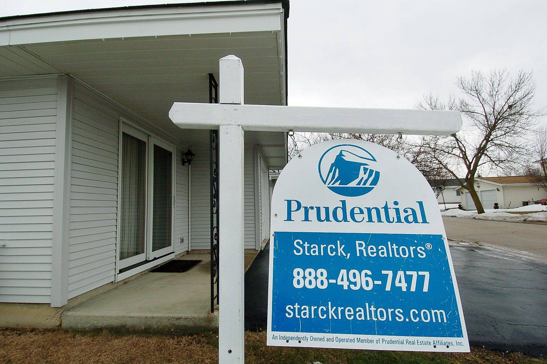 Sales of foreclosed homes dropped sharply in 2010, creating a glut of distressed homes that drags down the prices of other properties for sale.