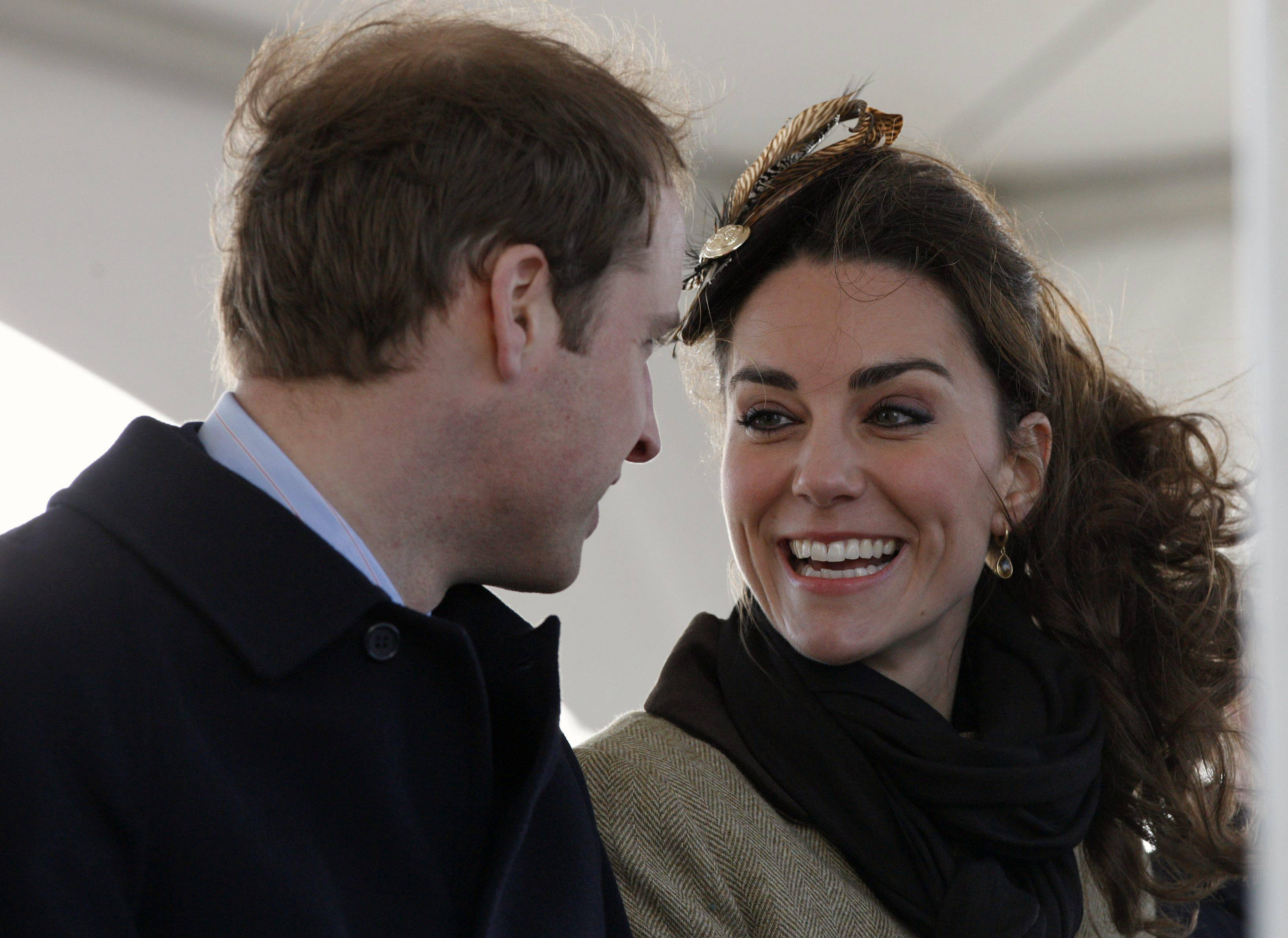 Britain's Prince William and his fiance Kate Middleton react following a naming ceremony and Service dedication for the Royal National Lifeboat Institution's new Atlantic 85 Lifeboat, at Trearddur Bay Lifeboat Station in Anglesey, Wales, Thursday.