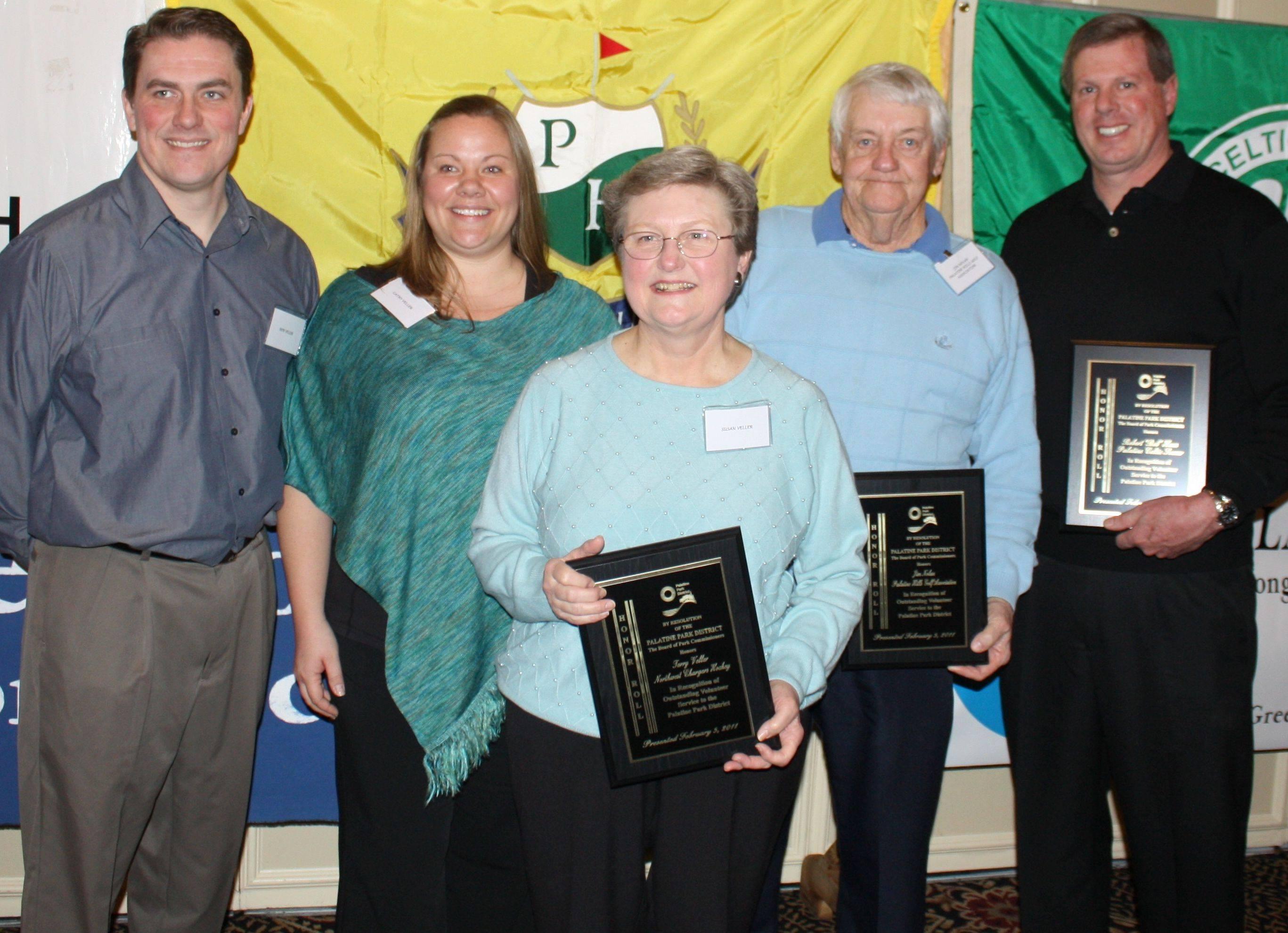 Honor Roll inductees, from left, the late Terry Veller's family, son Bob Veller; daughter Cathy Veller; and wife Susan Veller, who accepted the award on Terry's behalf; Jim Nolan and Bob Haas.