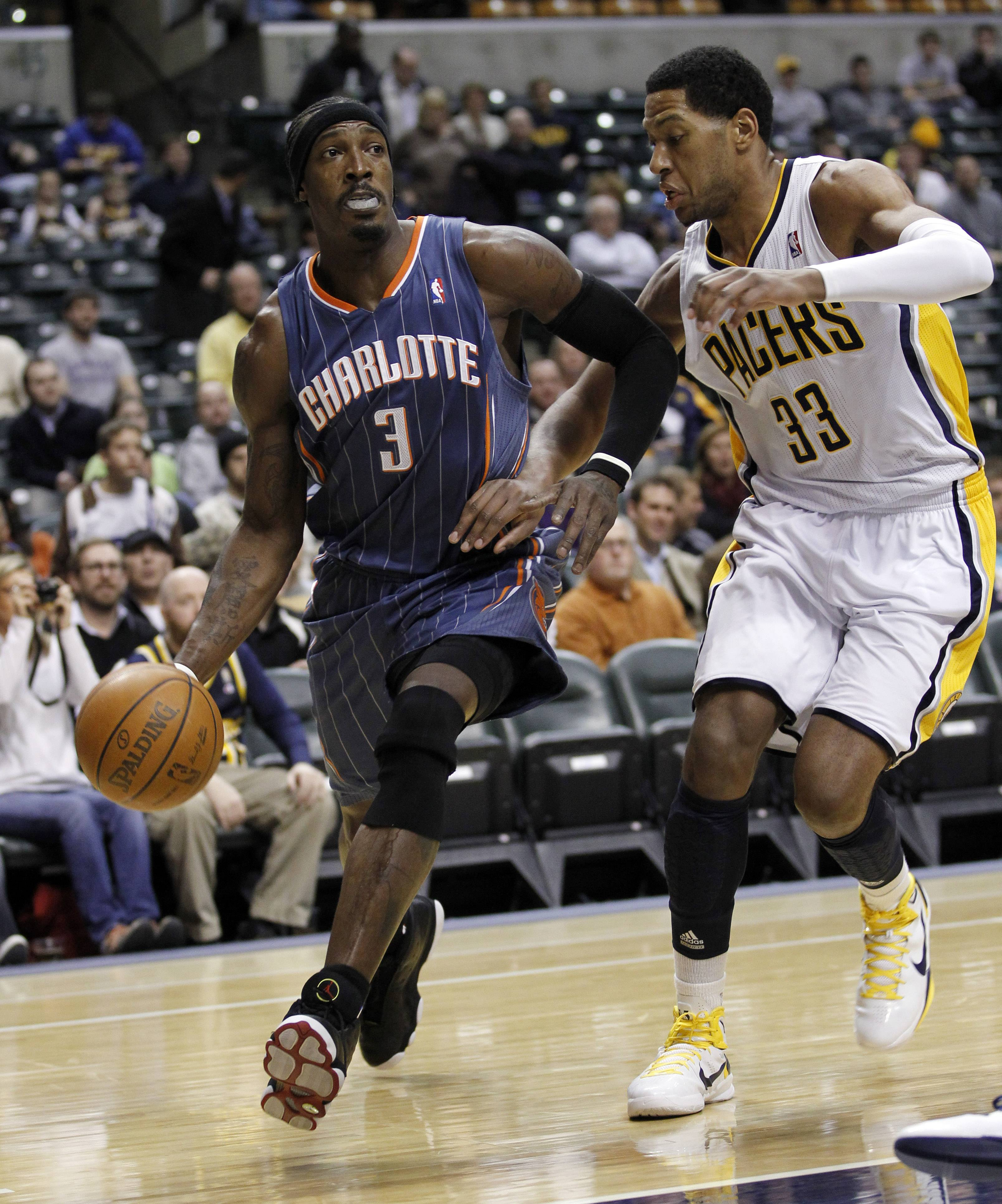 Charlotte Bobcats forward Gerald Wallace, left, drives on Indiana Pacers forward Danny Granger.