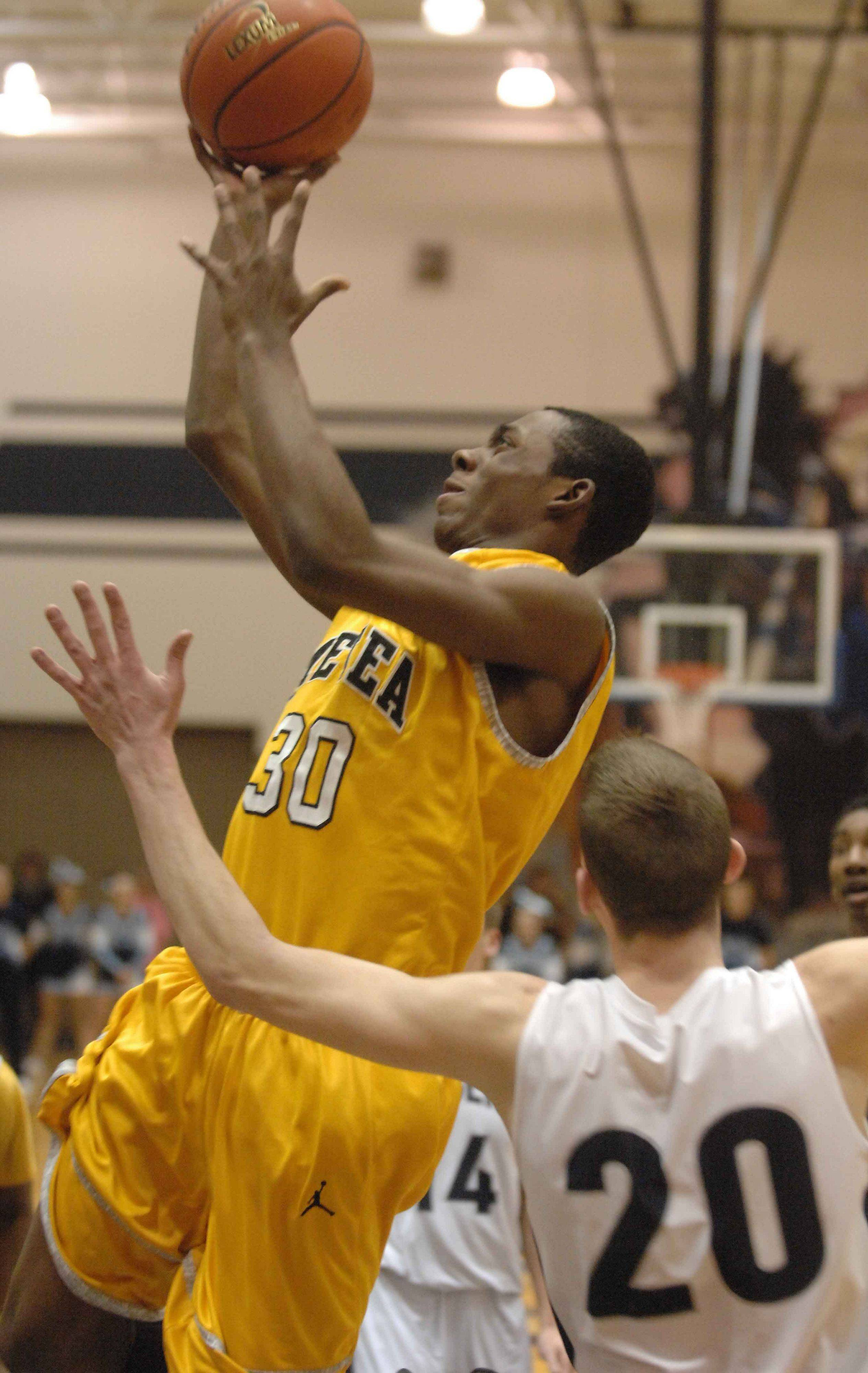 � Raysean Parker of Metea puts up a shot during the Metea Valley at Lake Park boys basketball game Thursday.