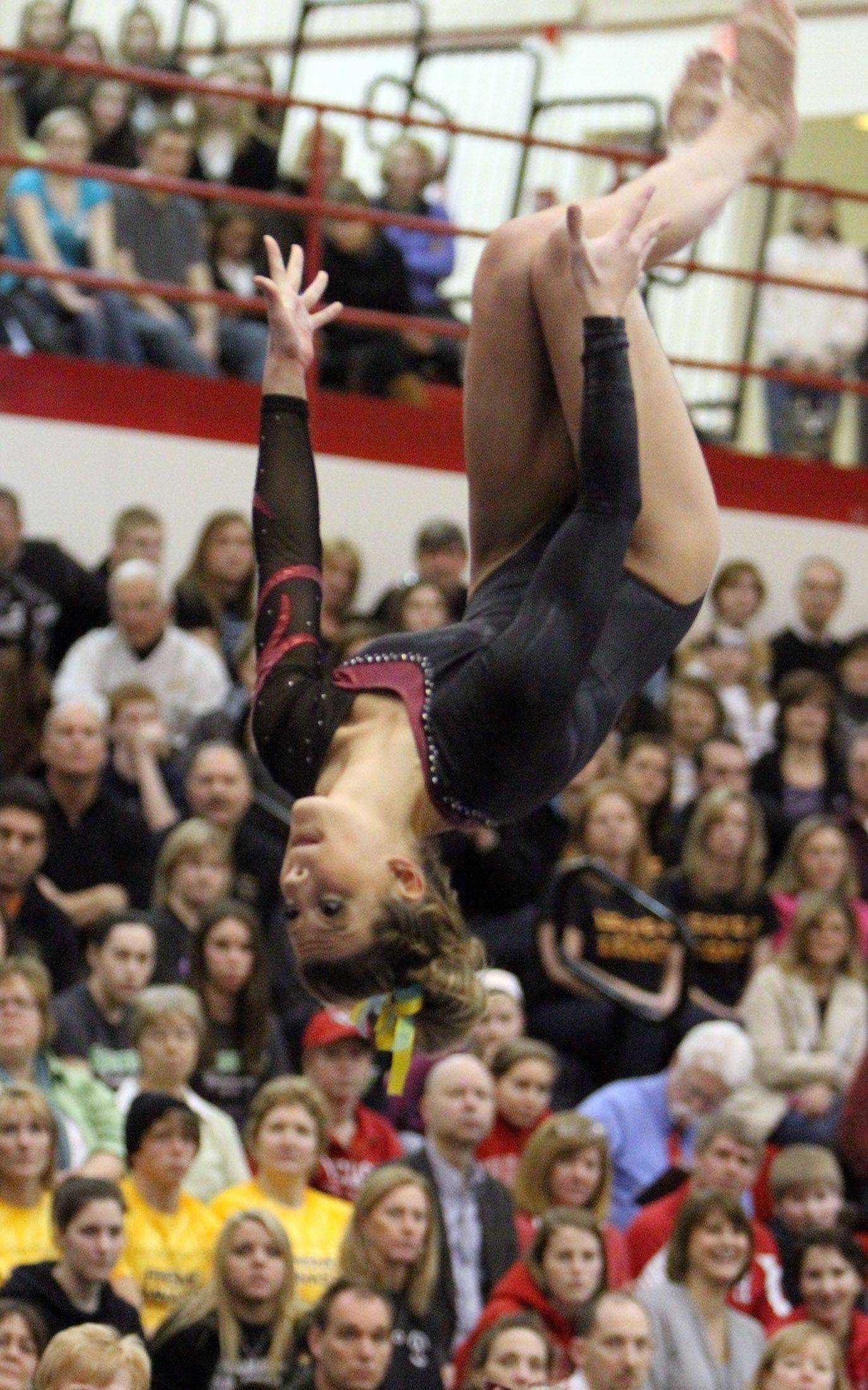 Schaumburg�s Brooke Shimon competes on the balance beam at the IHSA state gymnastics finals at Palatine on Saturday. Shimon finished third after earning a score of 9.55.