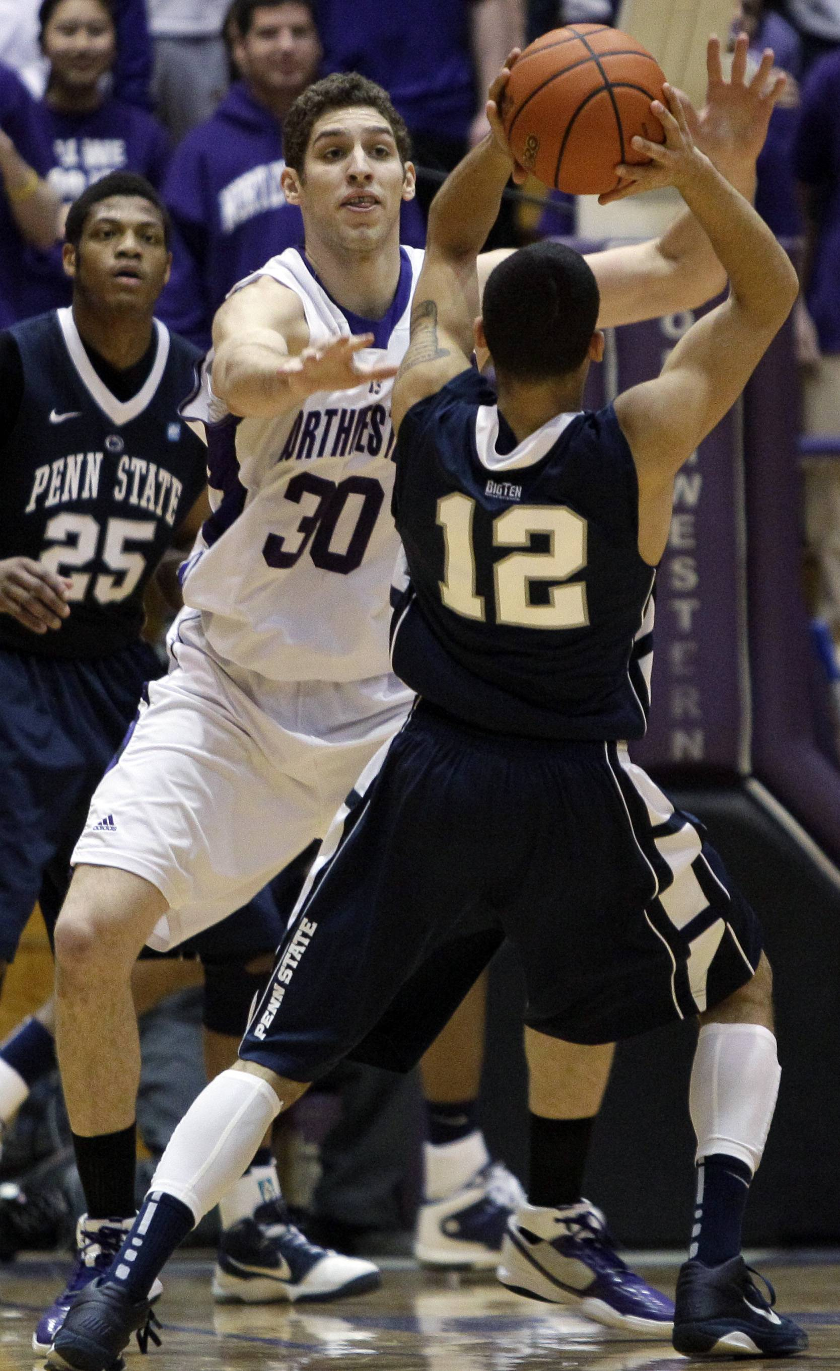 Northwestern's Davide Curletti guards Penn State's Talor Battle during the first half.