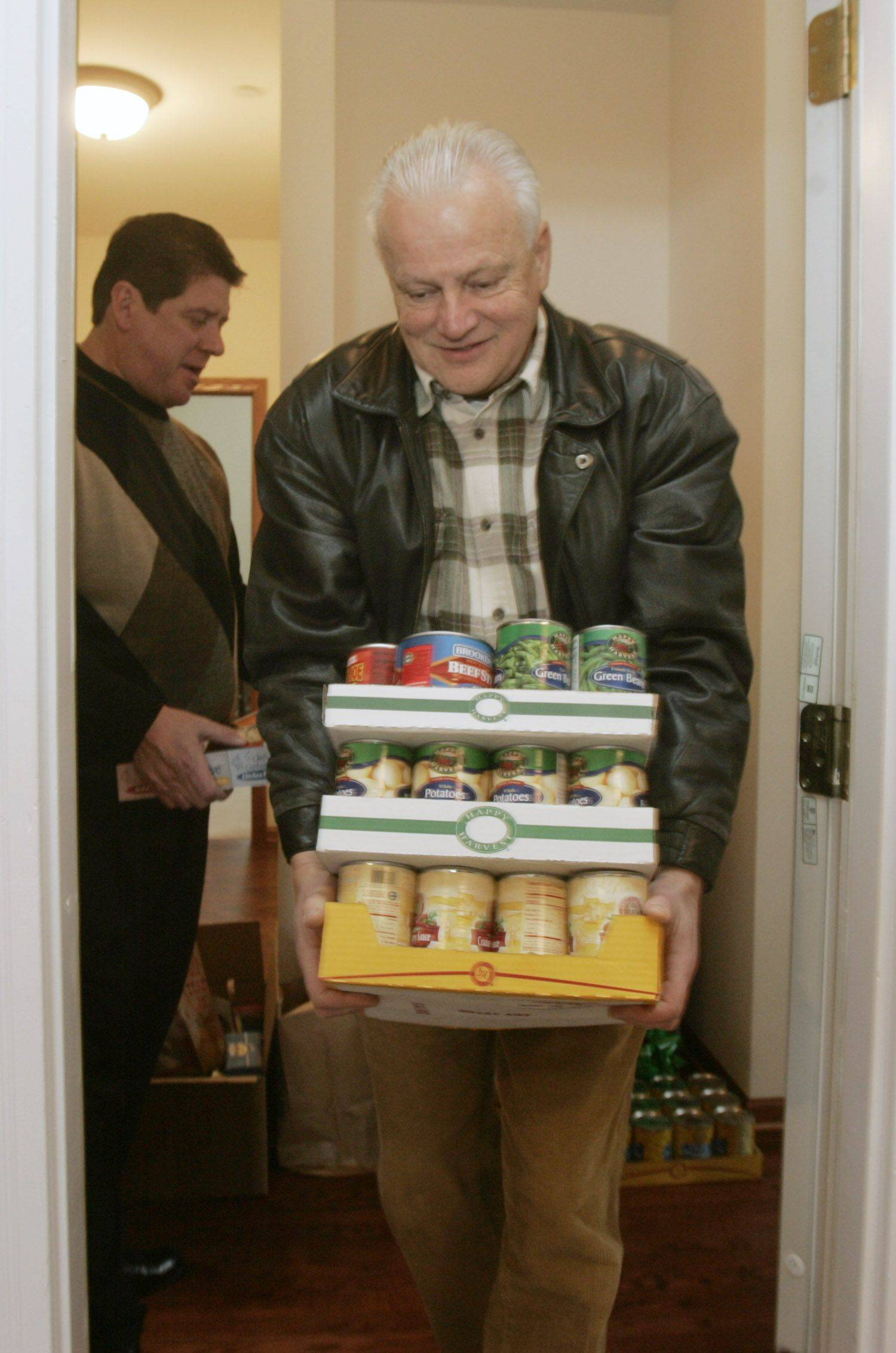 Algonquin-Lake in the Hills Interfaith Food Pantry president Richard Hoferle, here carrying food items, said he hopes to kick off a fundraising effort next month for a renovation project.
