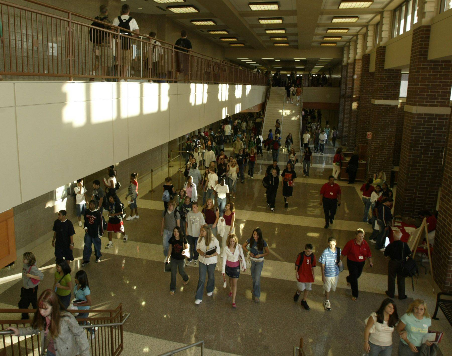 The halls fill fast after the ribbon cutting to open the new South Elgin High School in 2005.