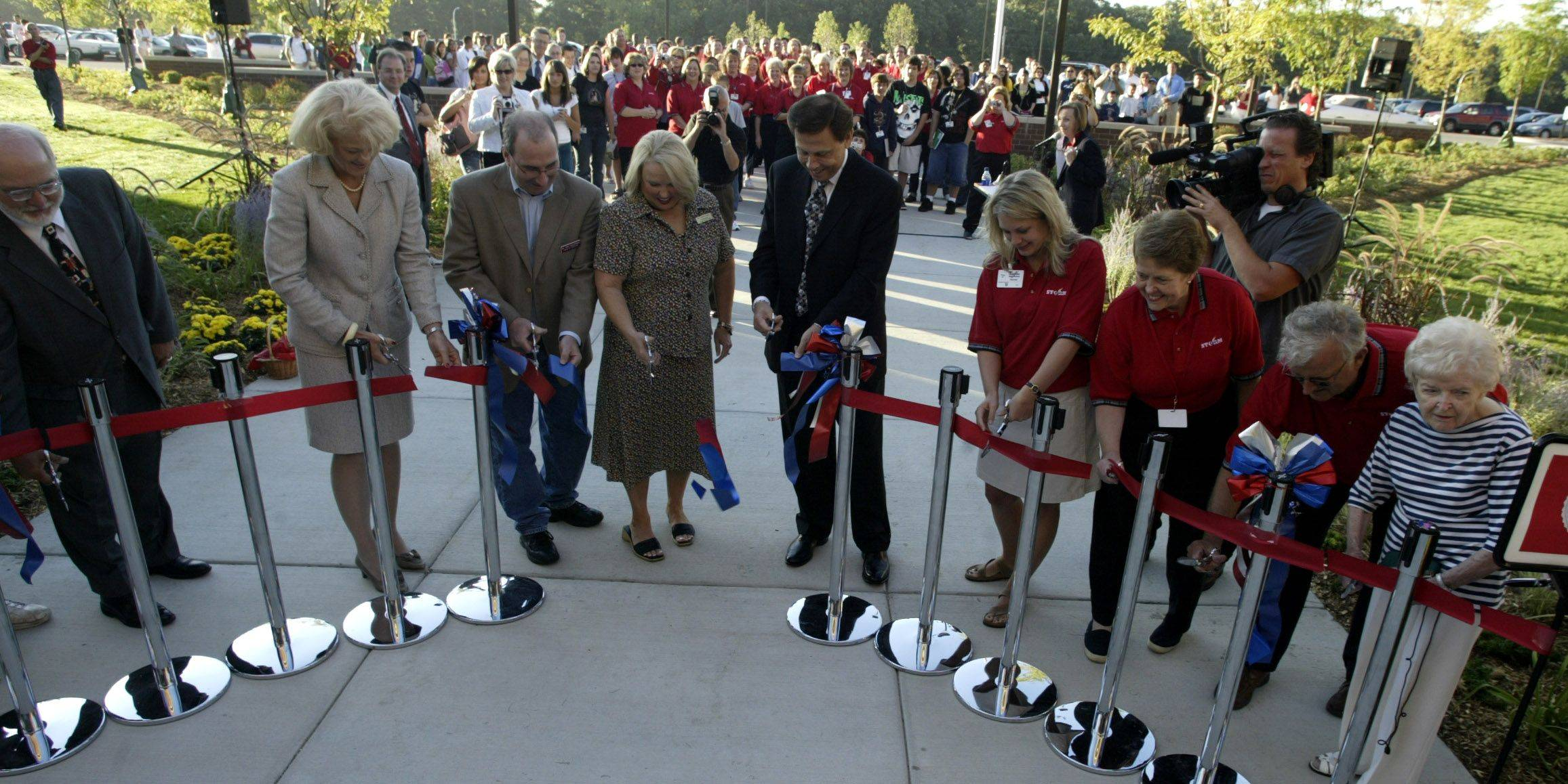 School and district officials, including then-Superintendent Connie Neale, center, cut the ribbon to start the first school day at the new South Elgin High School in 2005.