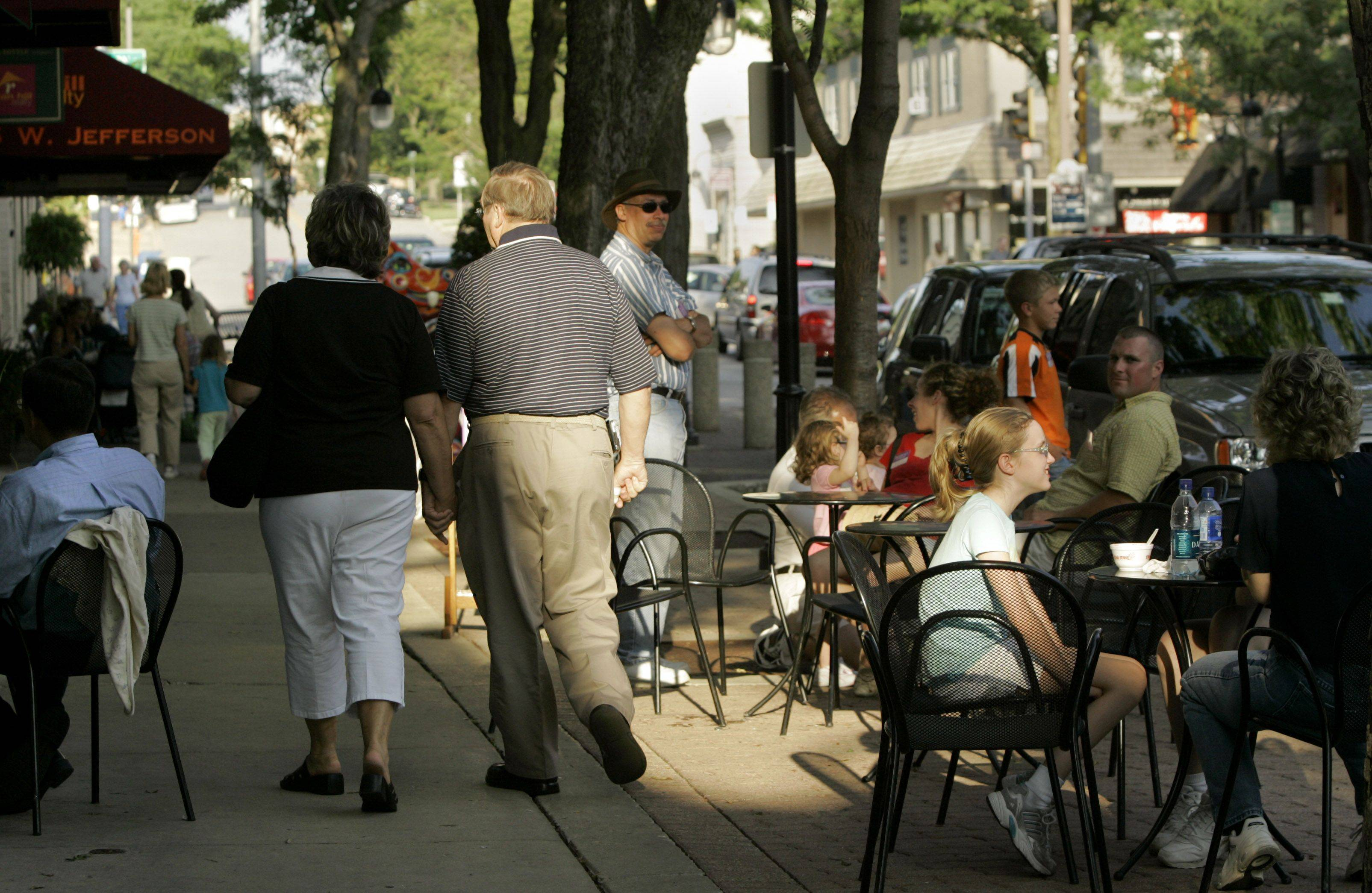 Summer in the city? No, downtown Naperville. Urban-style downtowns are a draw for new residents, experts say.