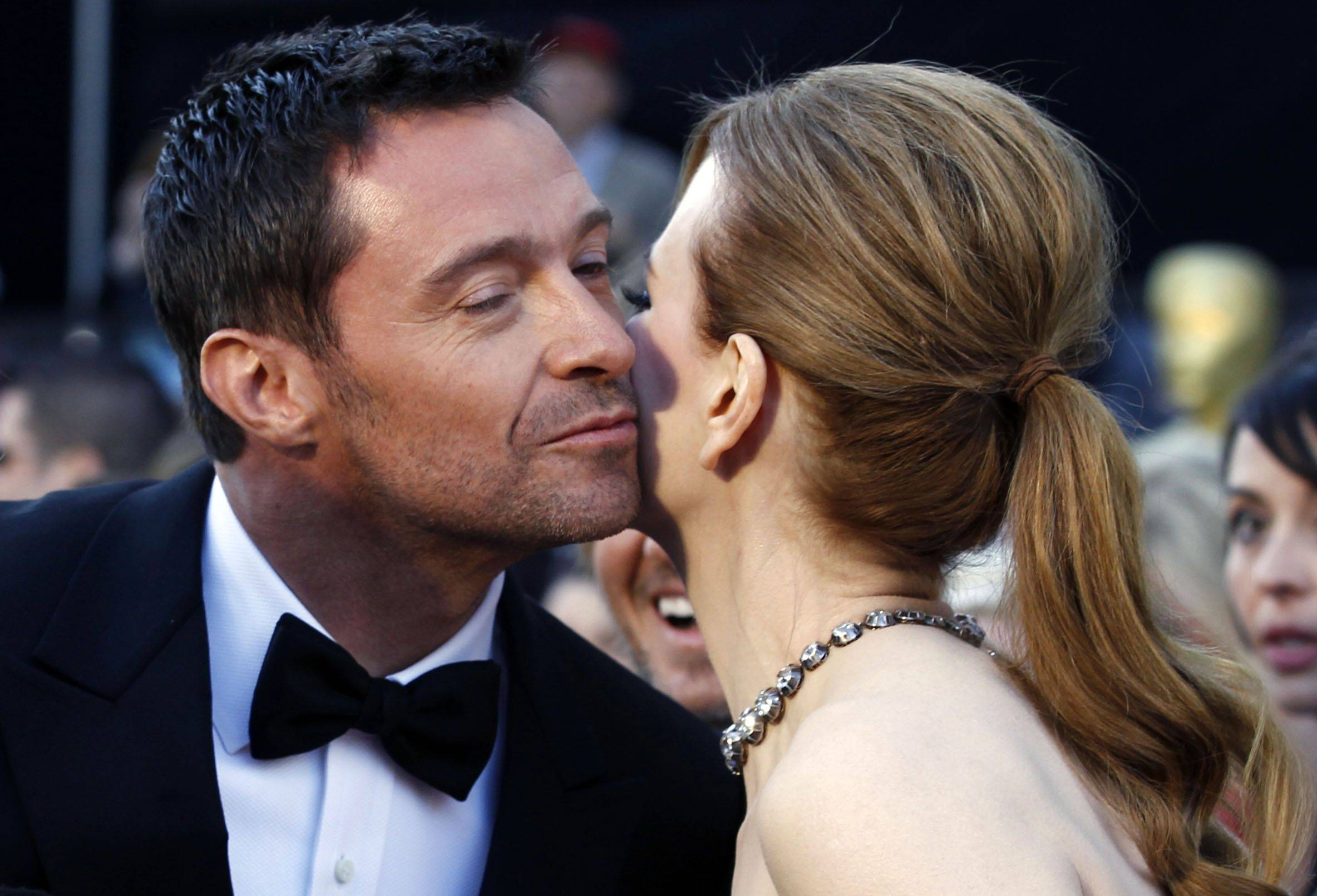 Associated PressActors Hugh Jackman and Nicole Kidman greet each other on the red carpet before their presenting gig during the show.