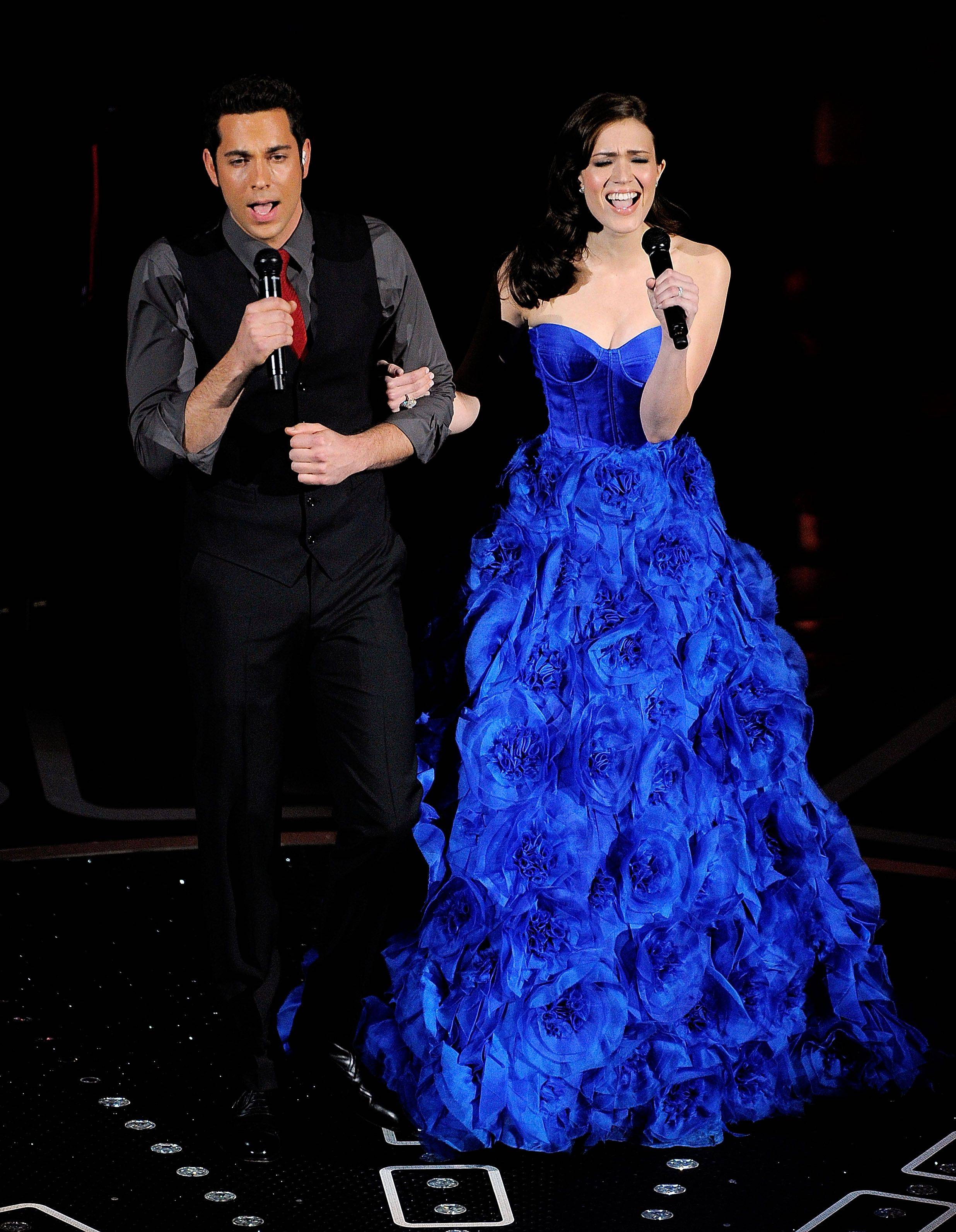 Associated PressActor Zachary Levi and Mandy Moore perform during the 83rd Academy Awards.