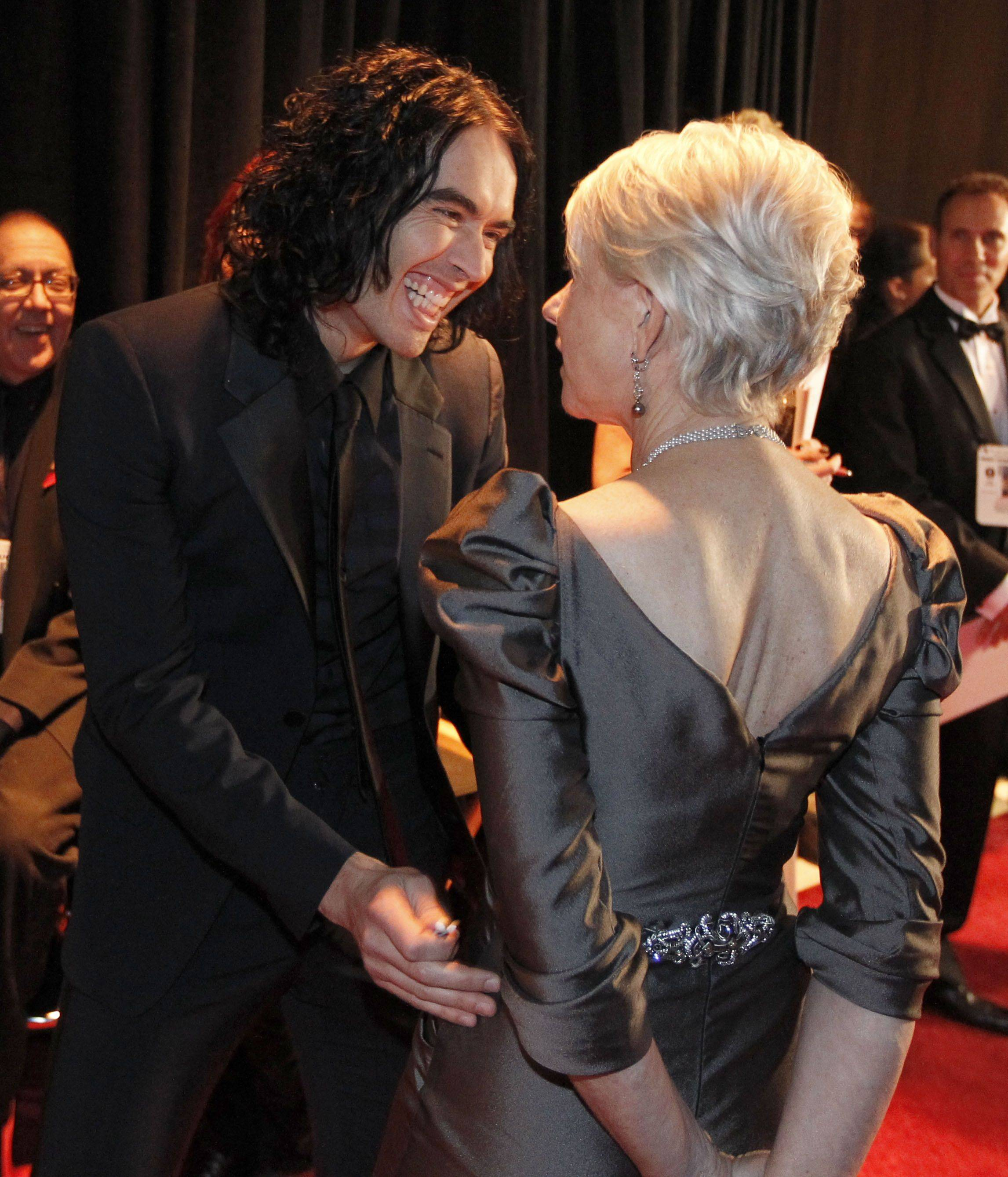 "Associated Press""Arthur"" co-stars Russell Brand and Helen Mirren are seen backstage at the 83rd Academy Awards."
