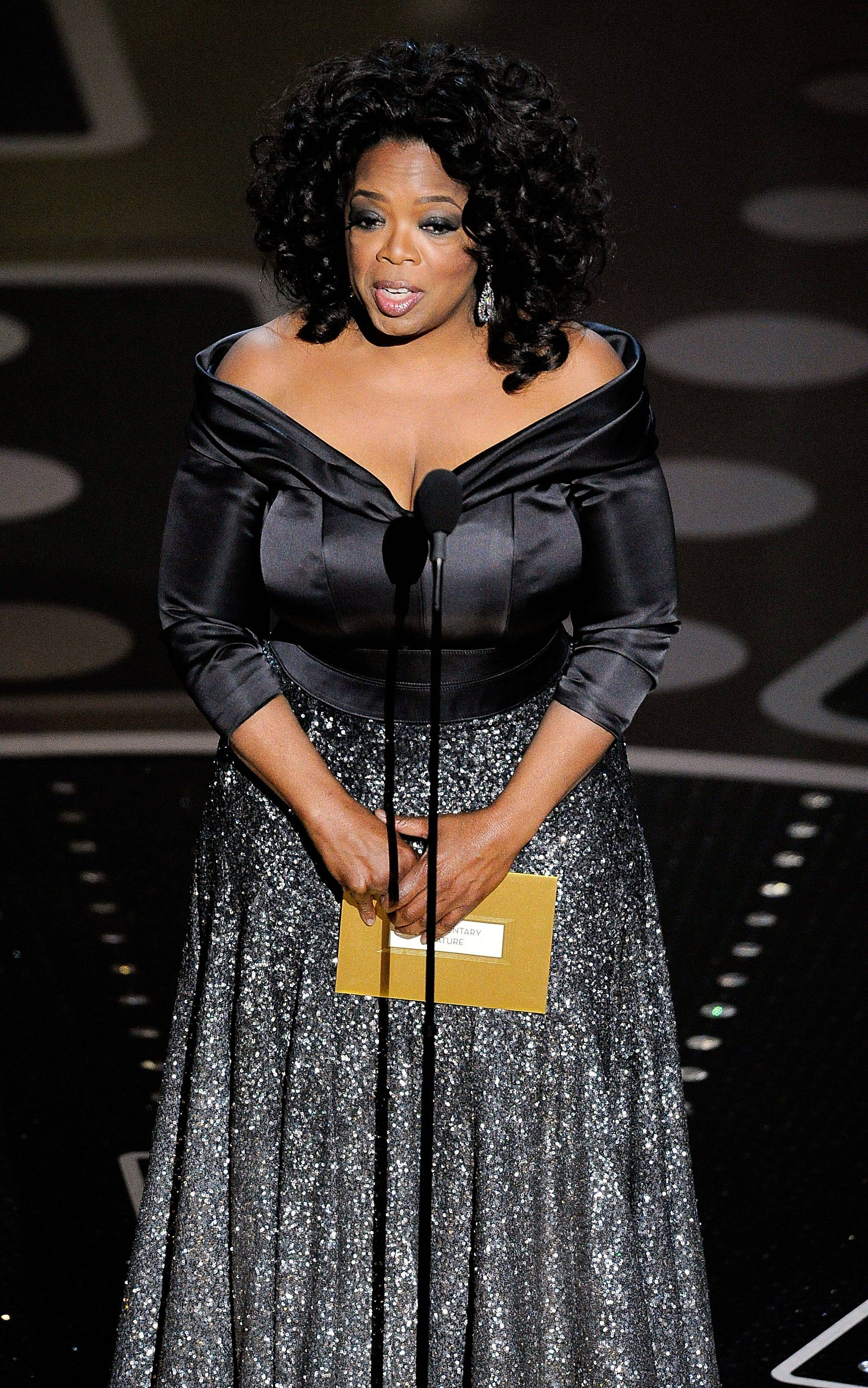 Associated PressOprah Winfrey presents the award for best documentary feature during the 83rd Academy Awards.