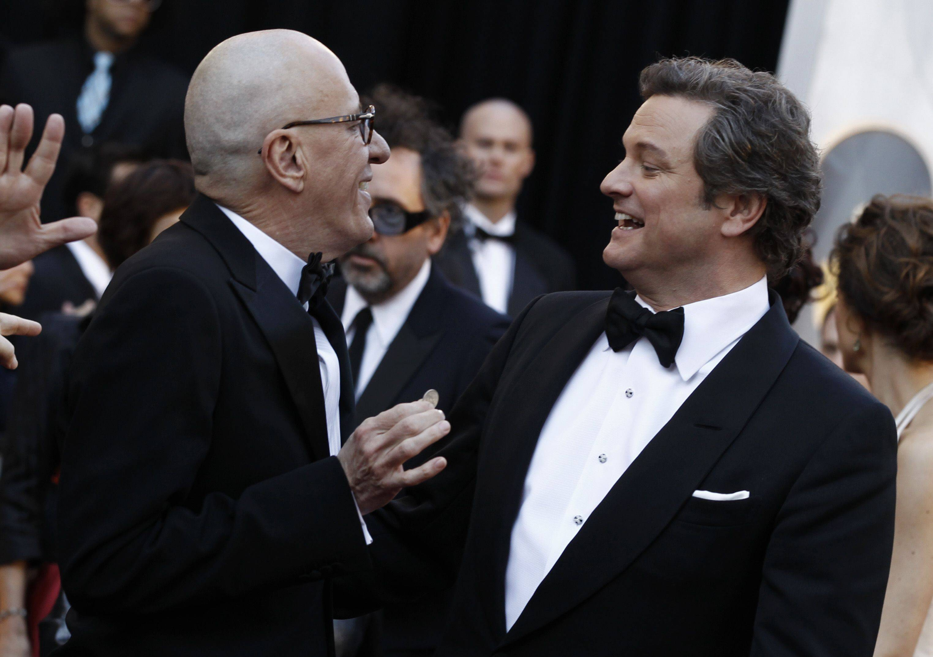 Associated PressActors Geoffrey Rush, left, and Colin Firth talk on the red carpet as they arrive.