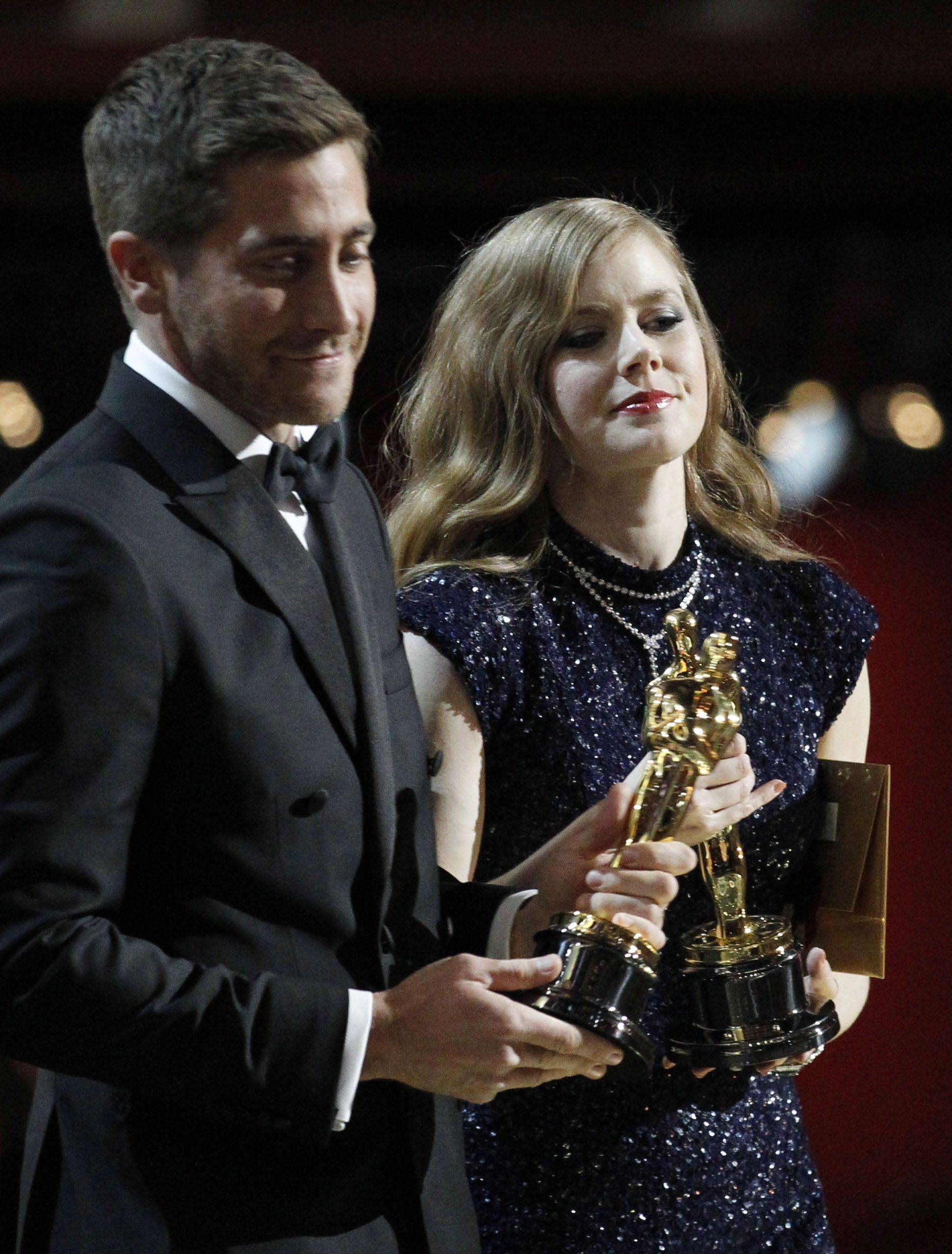 Associated PressJake Gyllenhaal, left, and Amy Adams present the awards for best live action short and best documentary.