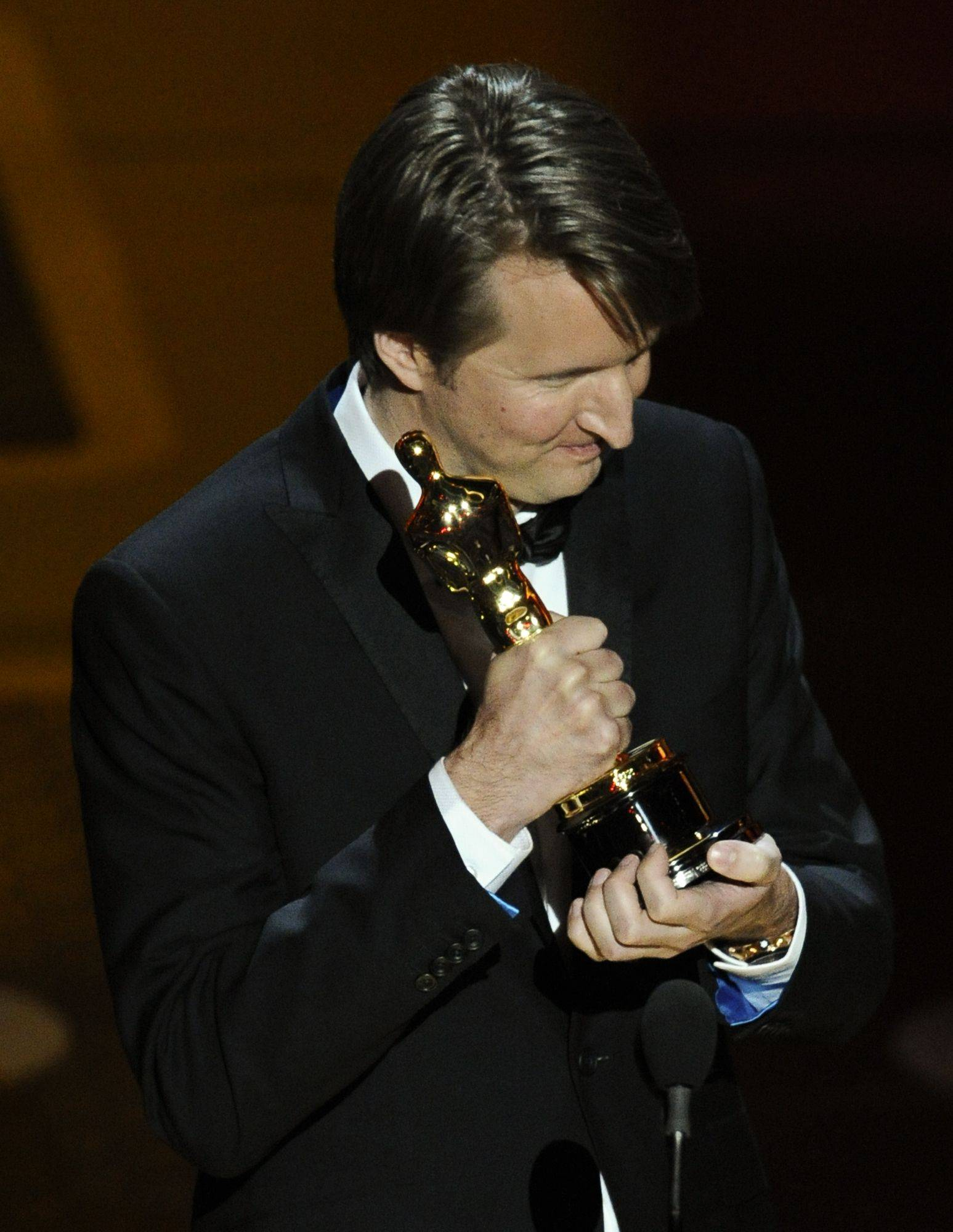 "Associated PressTom Hooper accepts the Oscar for best achievement in directing for ""The King's Speech."""