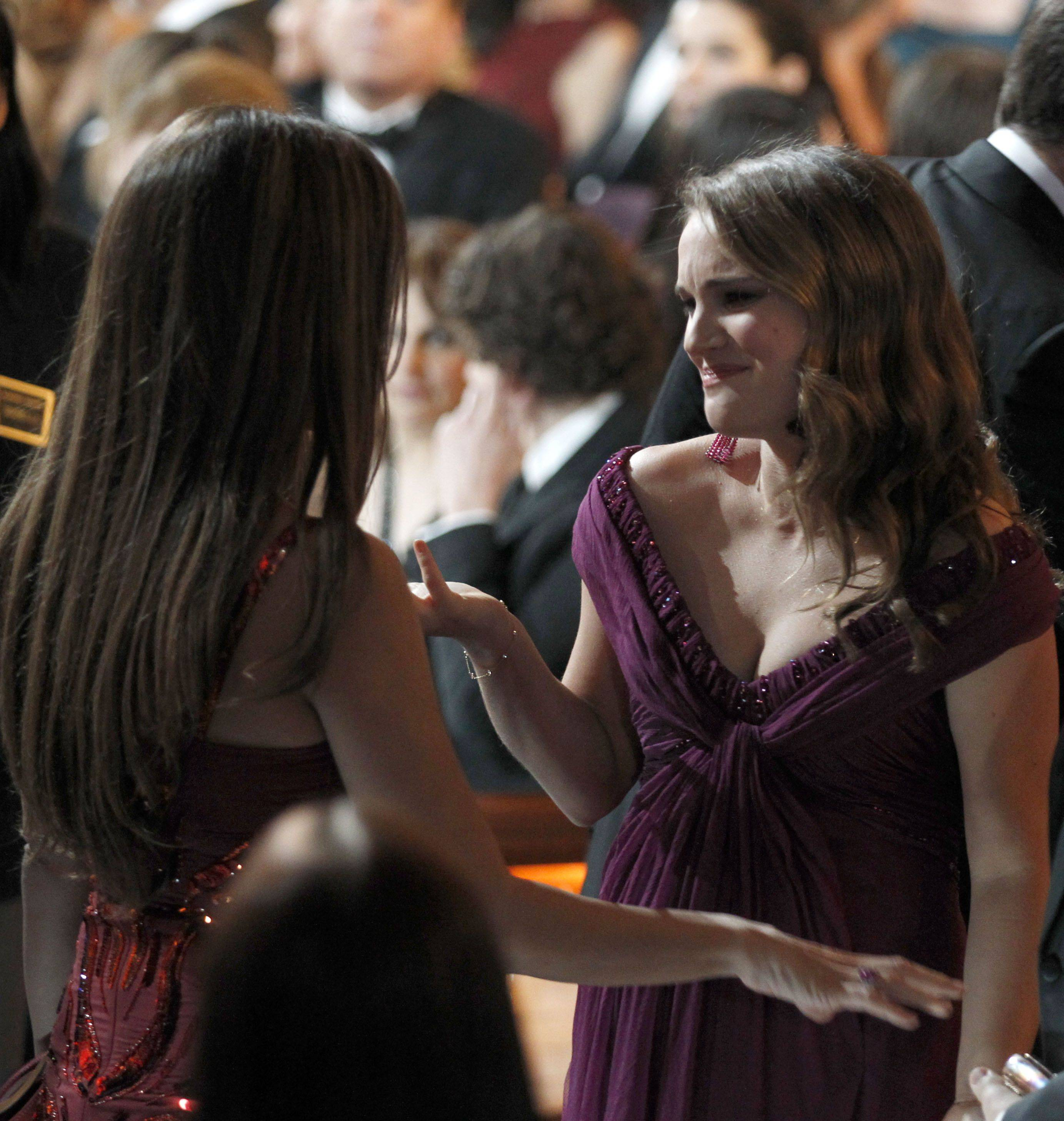 Associated PressOscar winners Penelope Cruz, left, and Natalie Portman get a minute to talk during a commercial break.