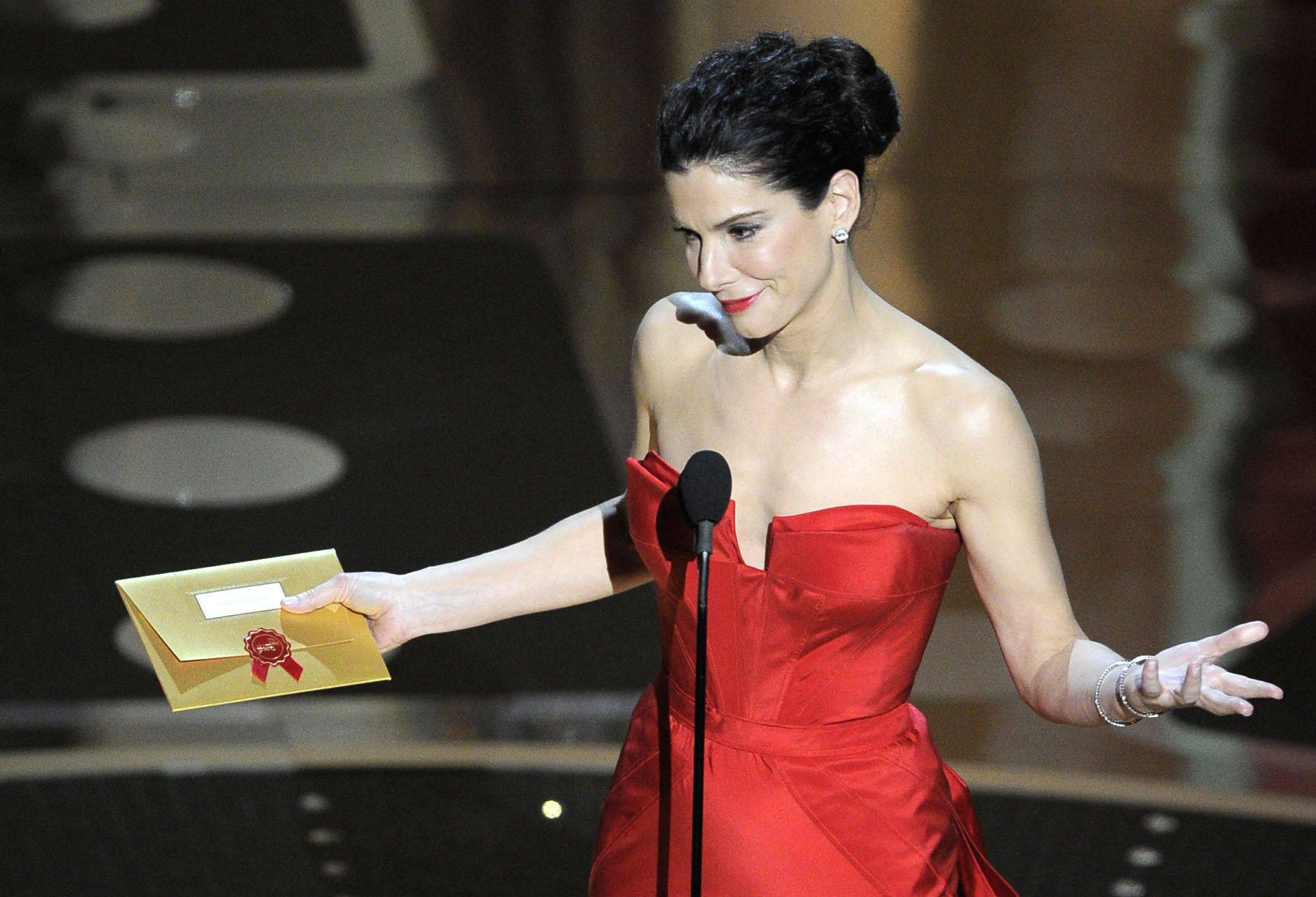 Associated PressOscar winner Sandra Bullock announces the winner of the best actor Oscar.