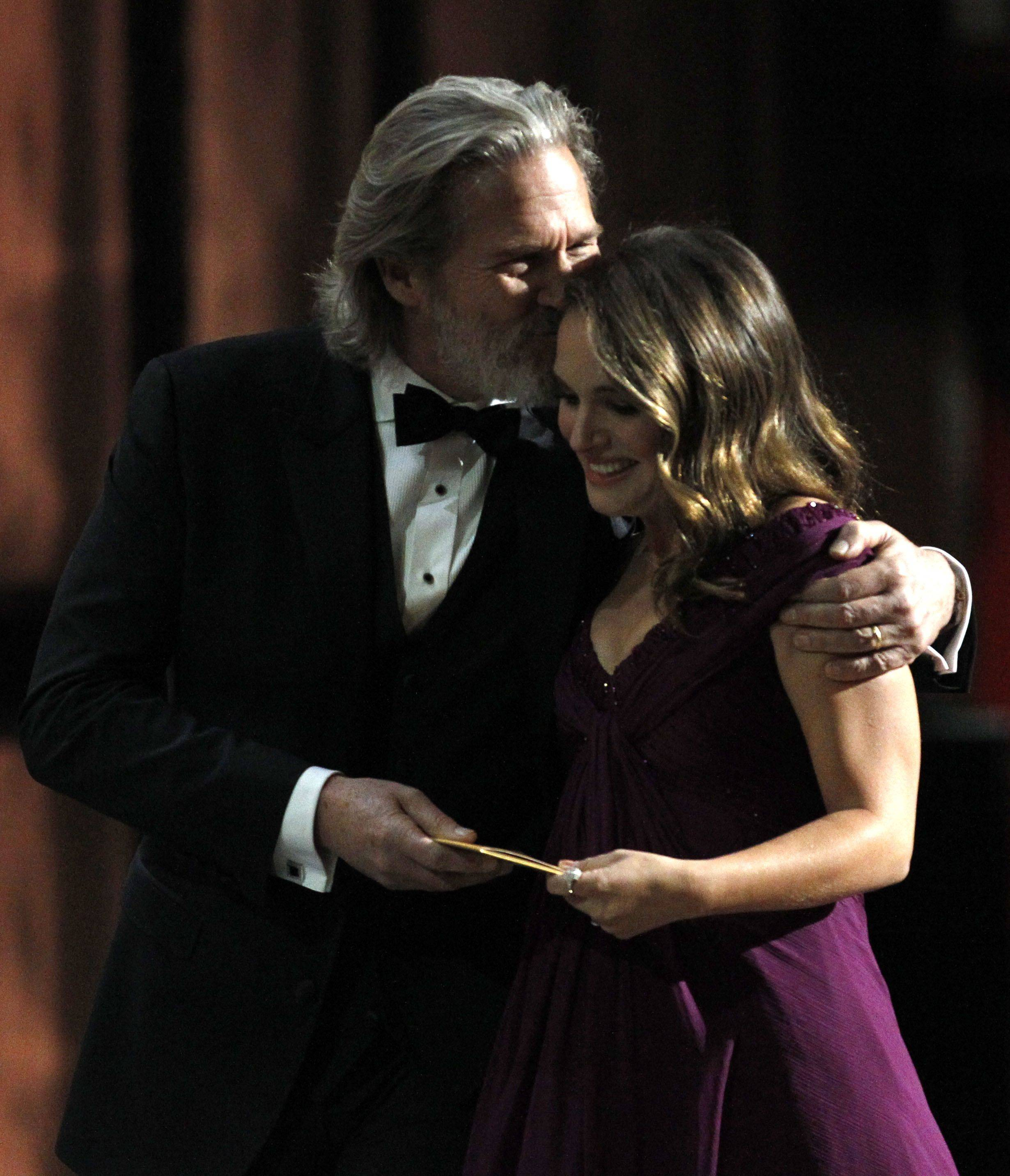"Associated PressJeff Bridges escorts Natalie Portman off the stage after her best actress win for ""Black Swan."""
