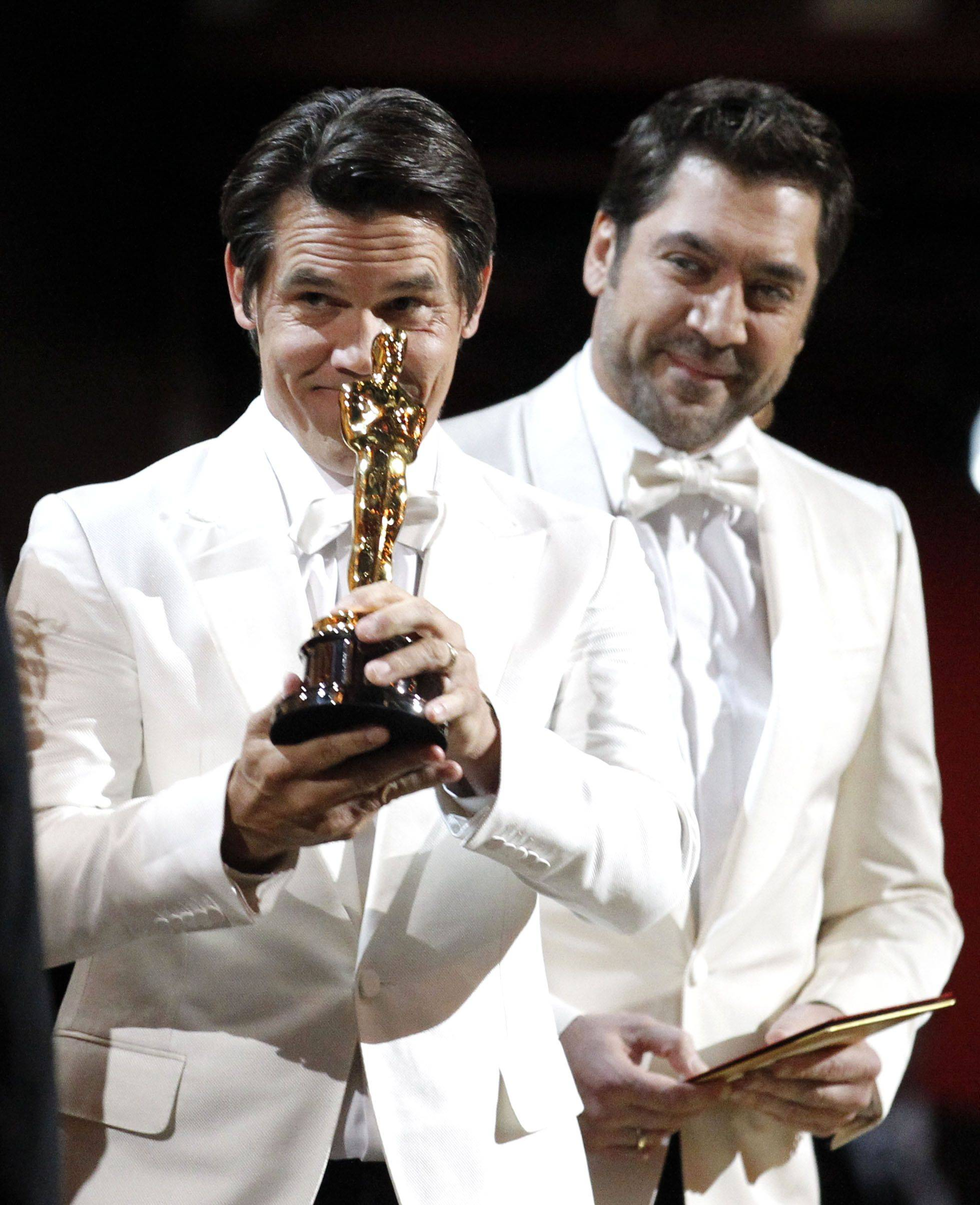 "Associated PressActors Josh Brolin, left, and Javier Bardem present the Oscar for best original screenplay to David Seidler for ""The King's Speech."""