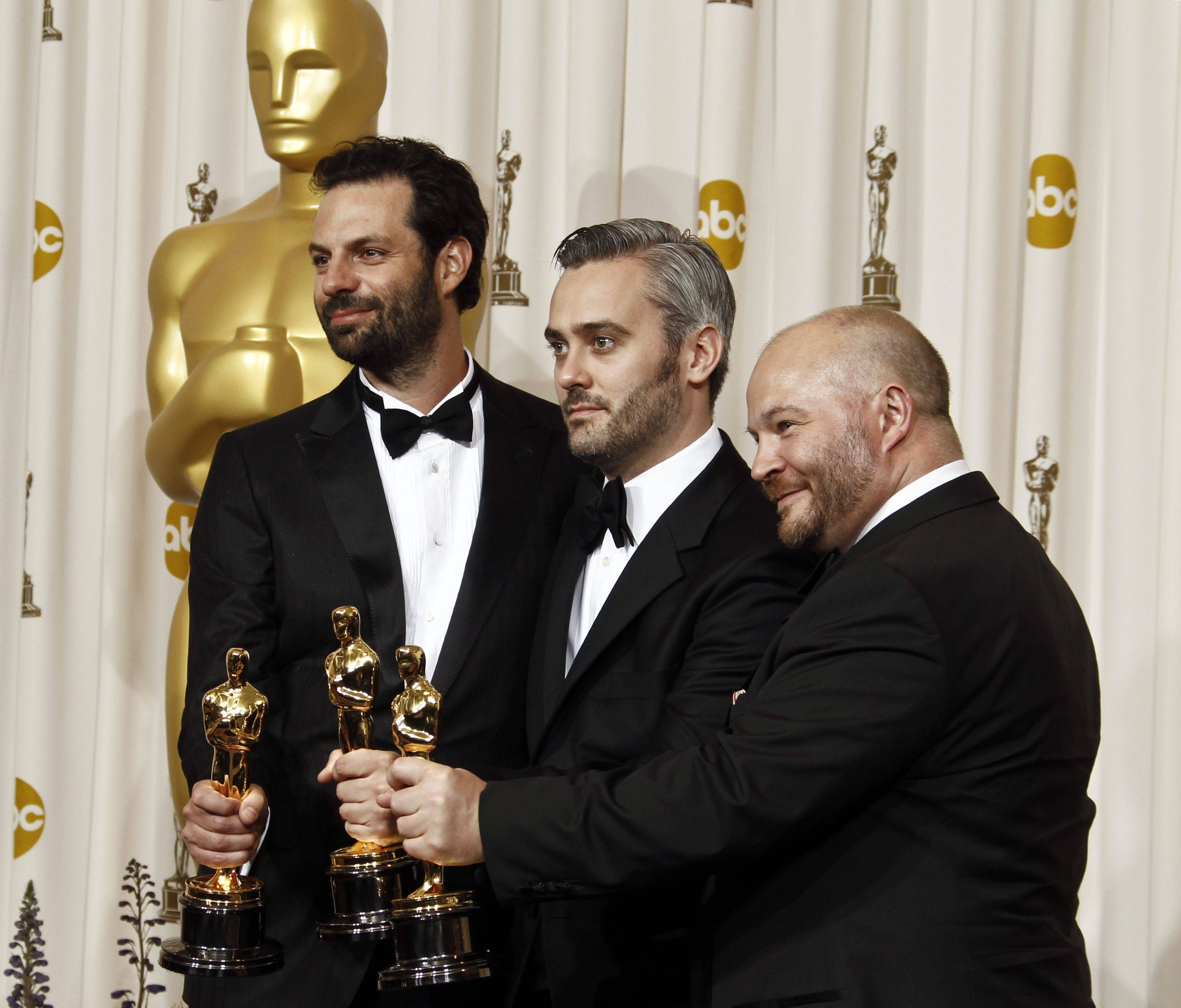"Associated PressEmile Sherman, left to right, Iain Canning and Gareth Unwin pose backstage with the Oscar for best motion picture for ""The King's Speech."""