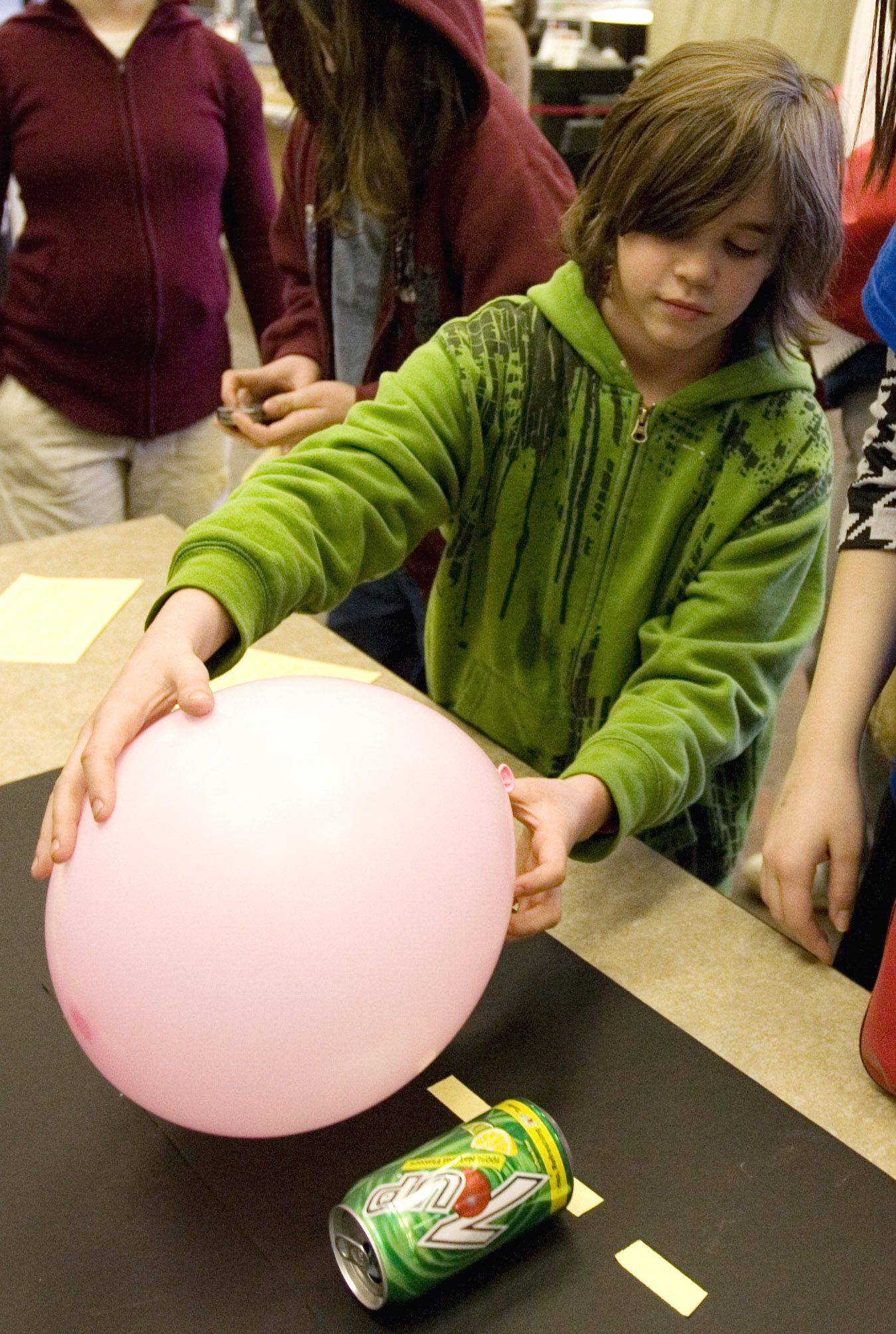 Harley Groleau, 9, of Medinah, tests a static electricity display during an open house on Sunday at Fermilab in Batavia.