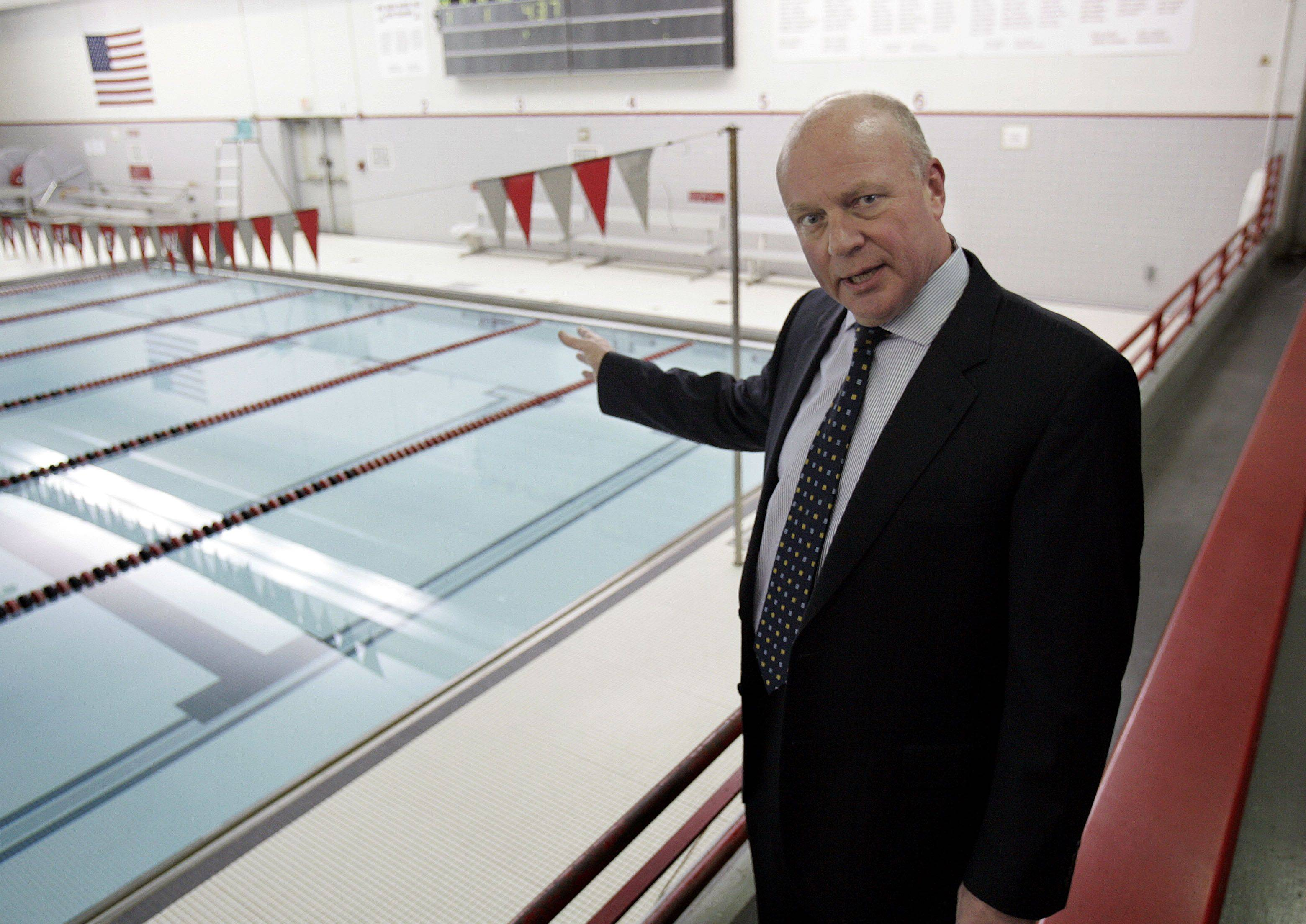 Business Manager Gary Lonquist points out the shallowness of the pool at Mundelein High School, one of the repair projects that is part of the April 5 referendum.