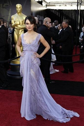 Actress Mila Kunis arrives before the 83rd Academy Awards on Sunday in the Hollywood section of Los Angeles.