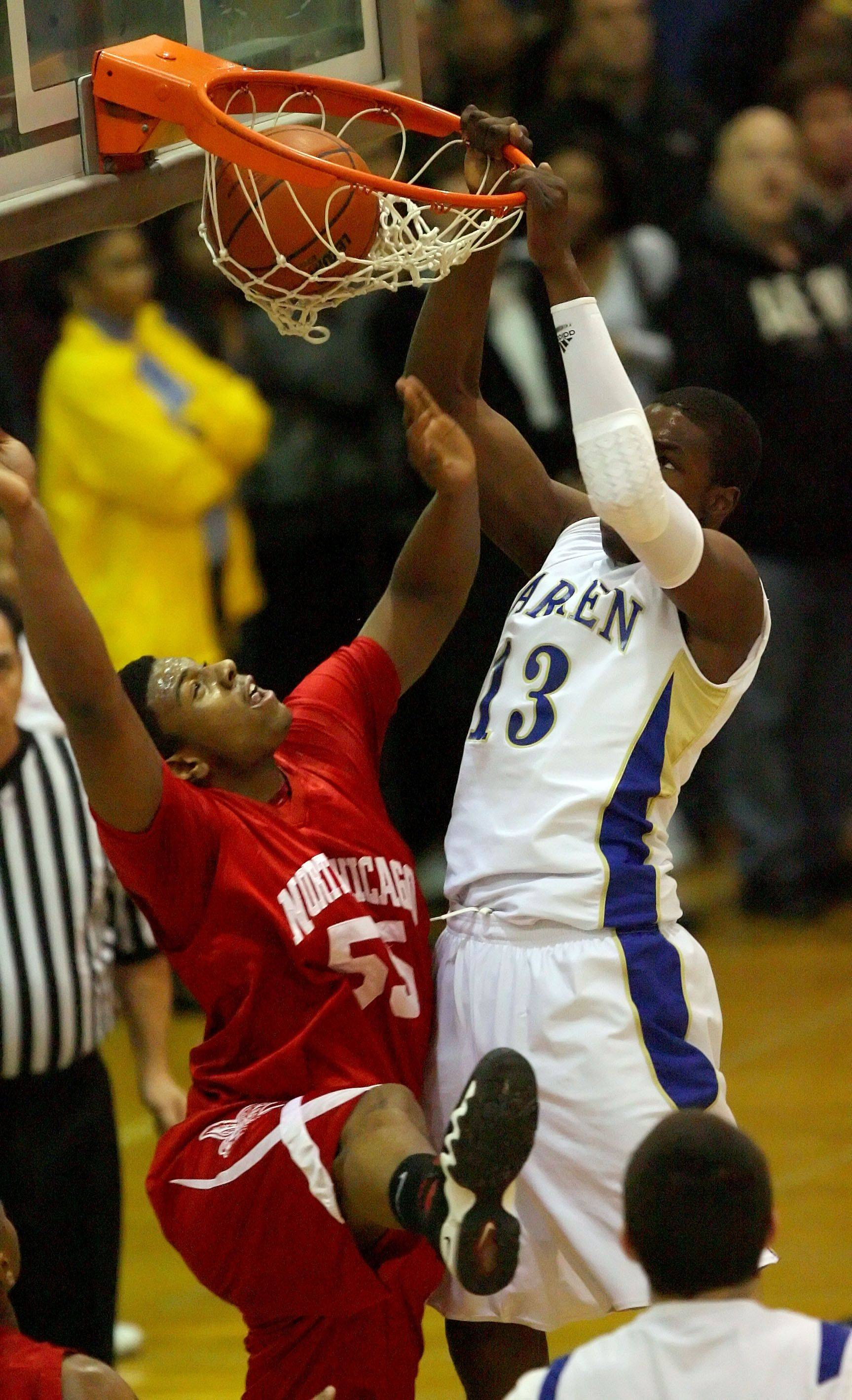 Warren's Darius Paul dunks over North Chicago's Jaylin Linson during the NSC title game Wednesday night in Gurnee.