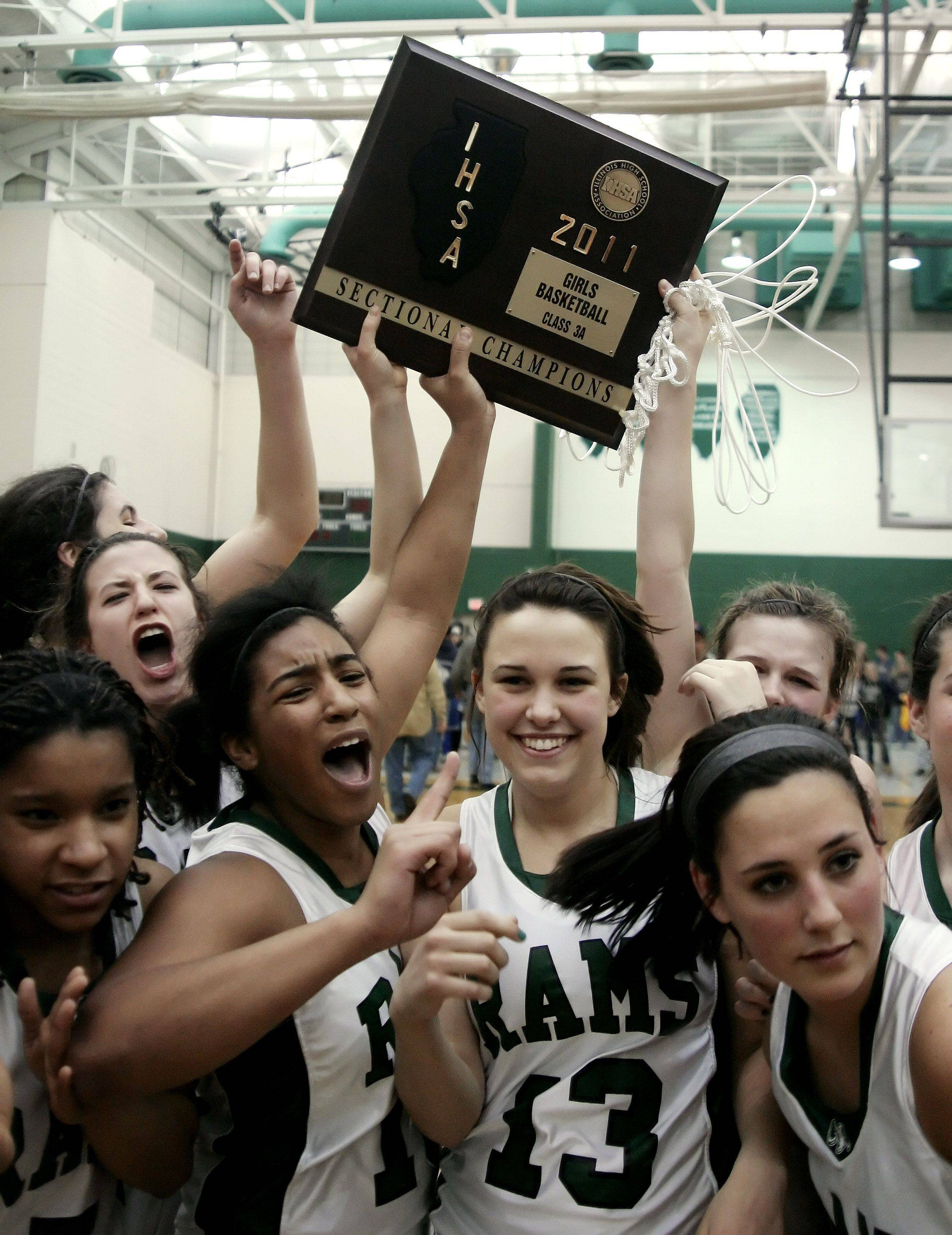 Graylake Central girls hoist the sectional plaque after defeating Johnsburg in the Class 3A sectional game Thursday.