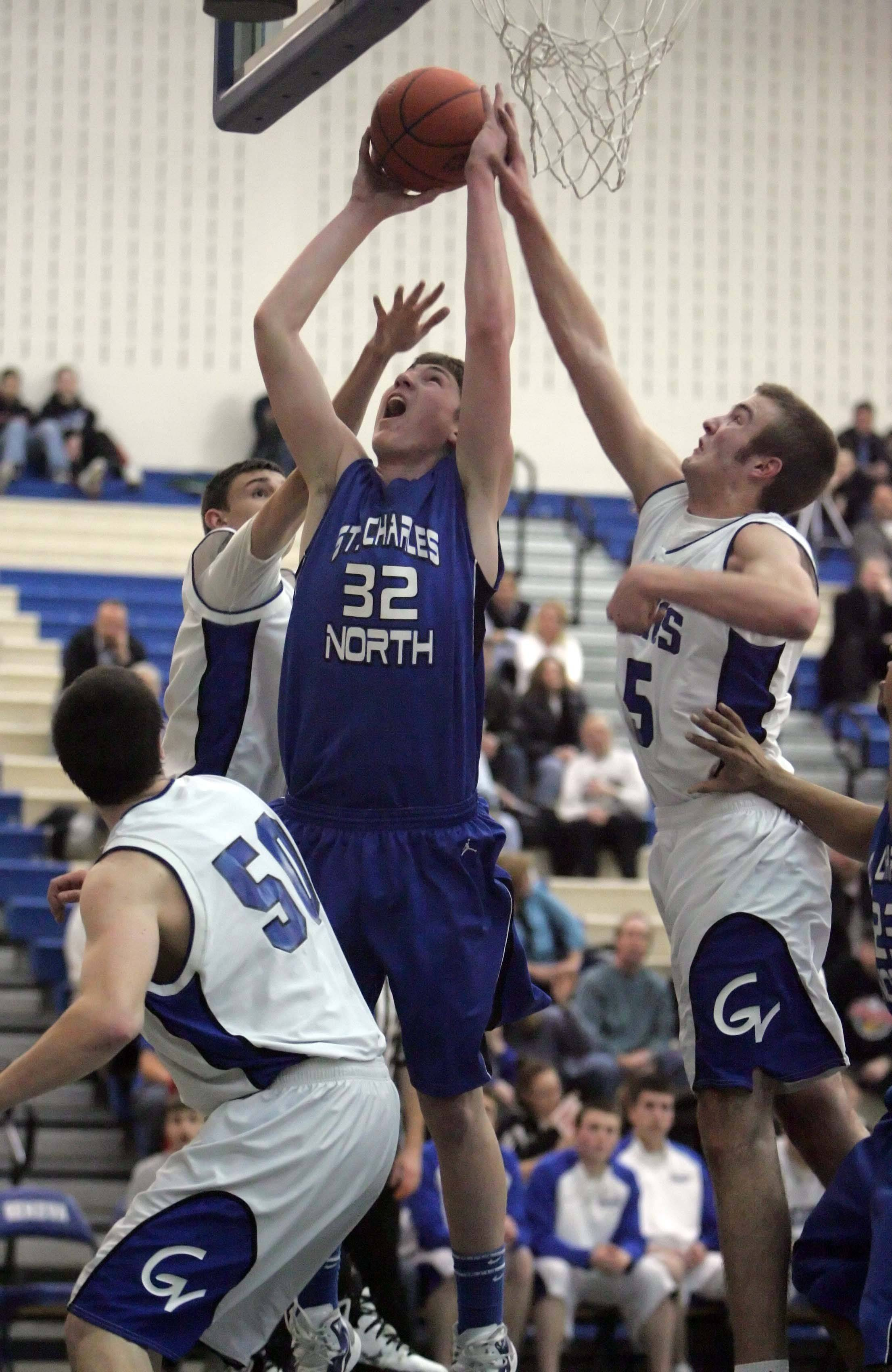 St. Charles North's Kyle Nelson, 32, goes to the hoop during Friday's game against Geneva.