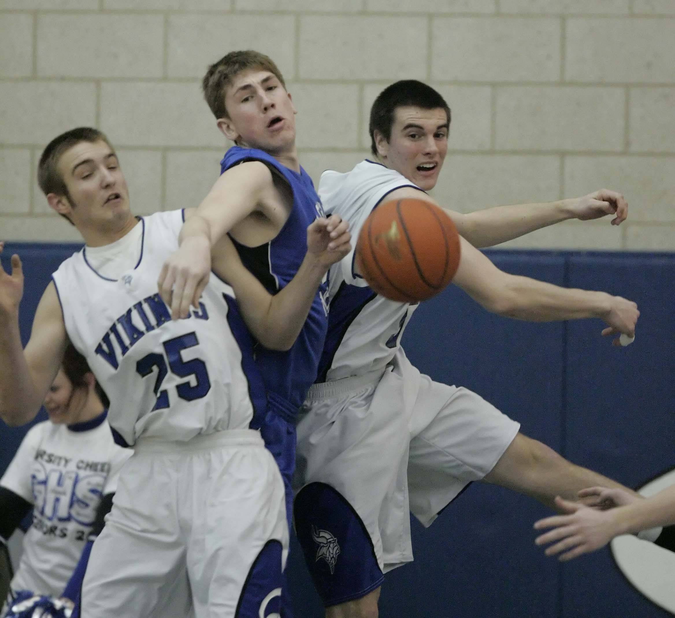 Geneva's Dan Trimble, 25, and Brad Bernhard, 50, pressure St. Charles North's Kyle Nelson during Friday's game.