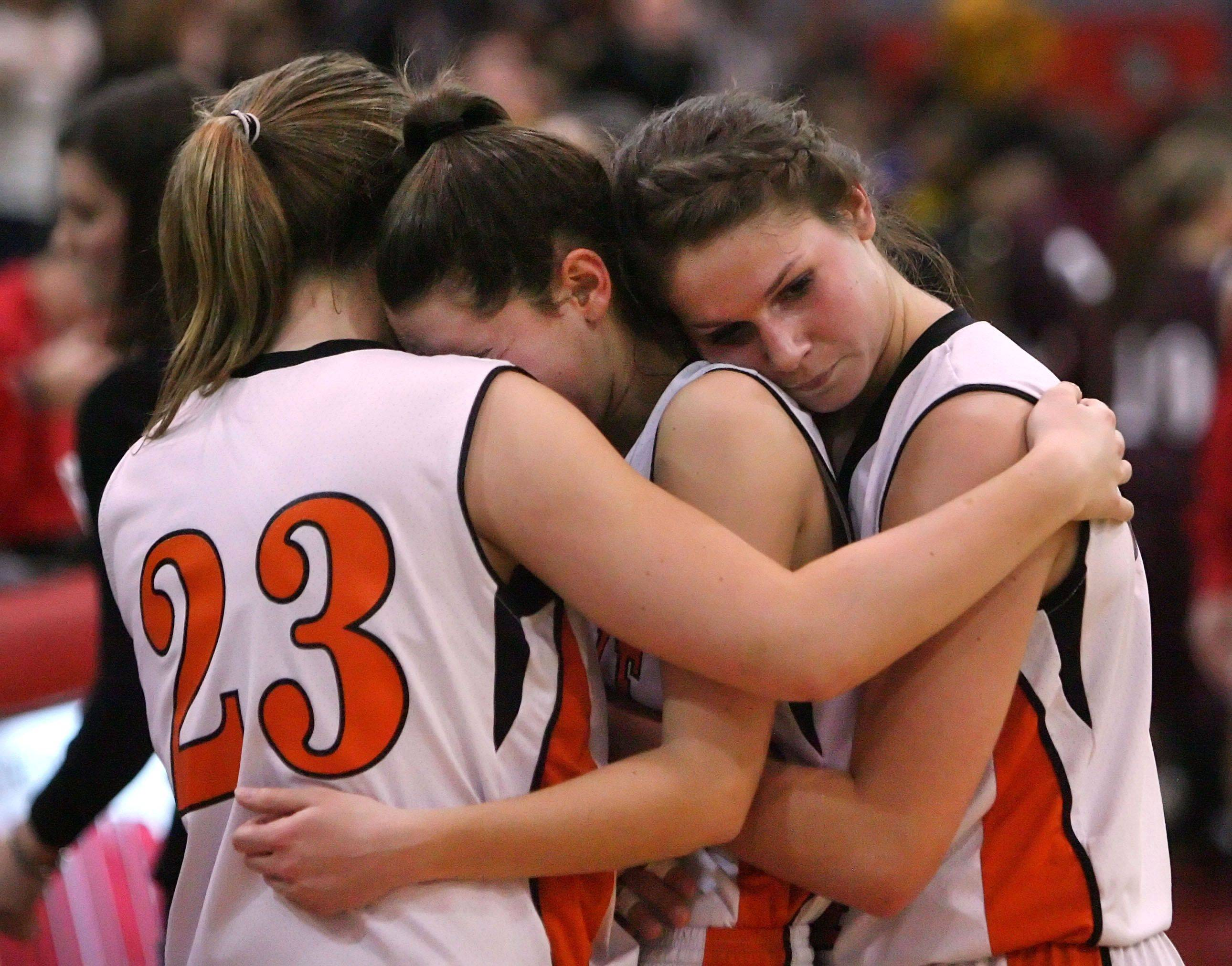 Libertyville girls from left, Molly Moon, Valerie Van Roeyen and Kaca Savatic embrace after losing to Zion-Benton in the sectional semifinals Monday night at Mundelein High School.